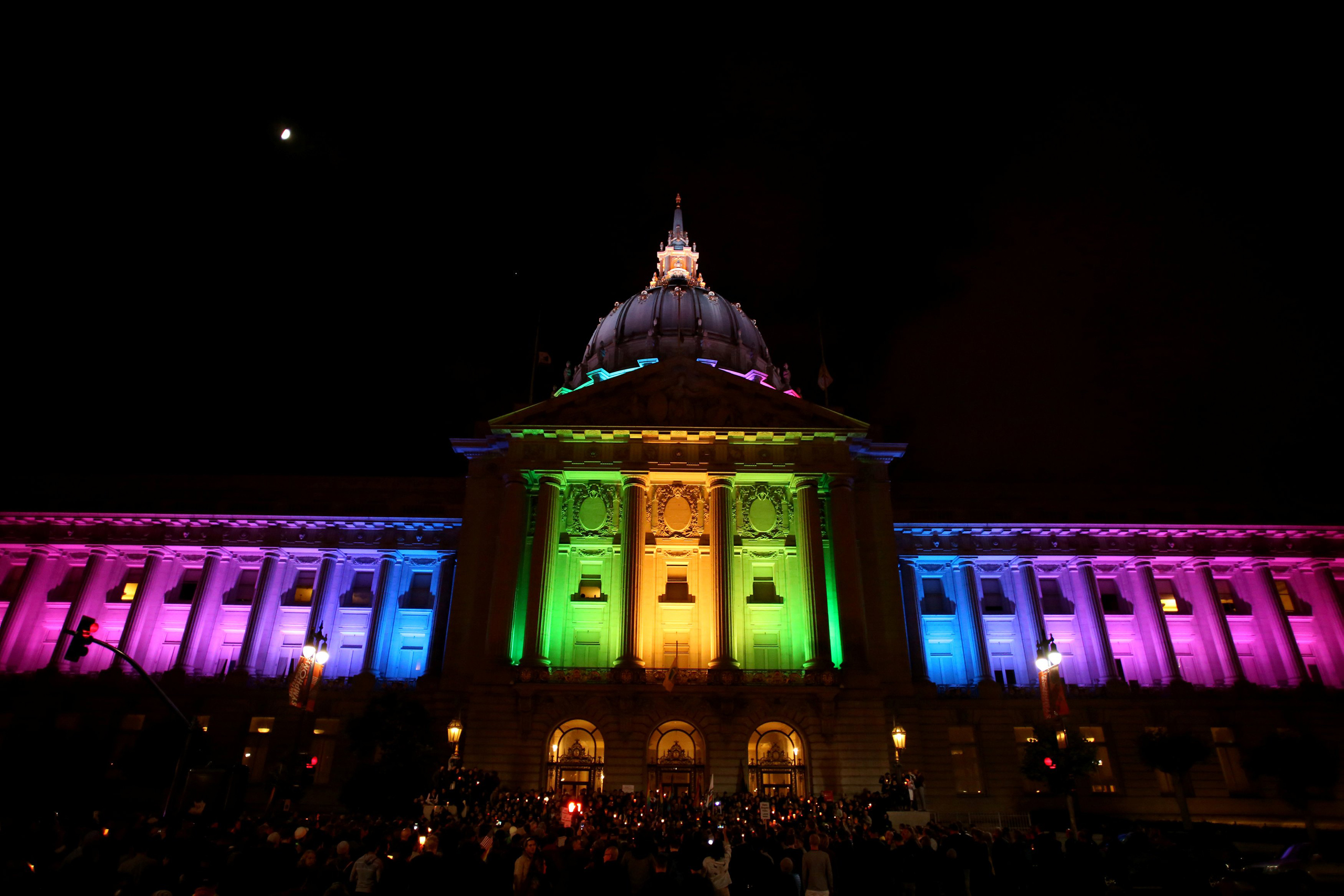 People attend a candlelight vigil for the victims of the attack on a gay nightclub in Orlando, held in San Francisco on June 12, 2016.