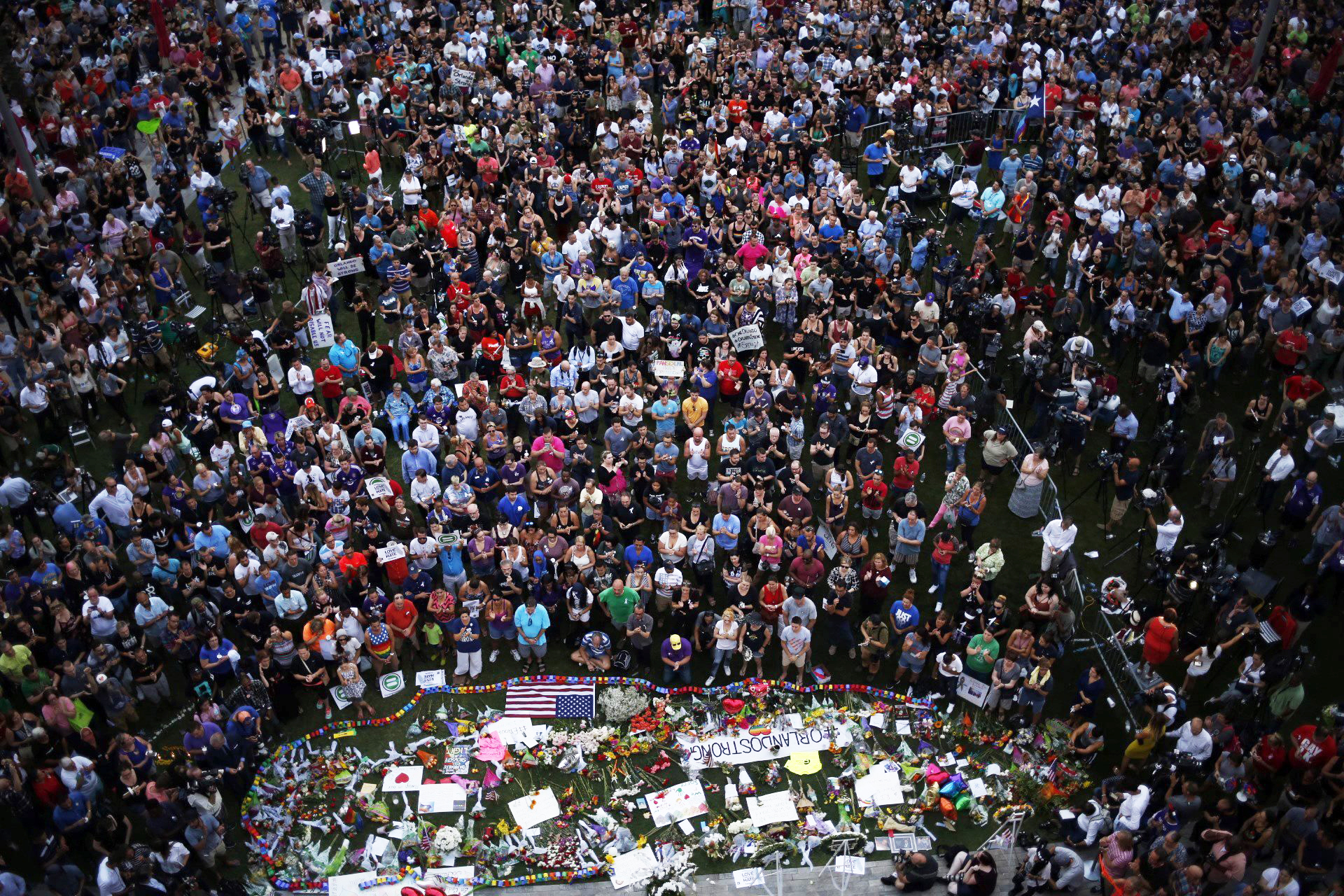 Hundreds of people gather at a memorial outside of the Dr. Phillips Center for the Performing Arts in Orlando, Fla., on June 13, 2016.