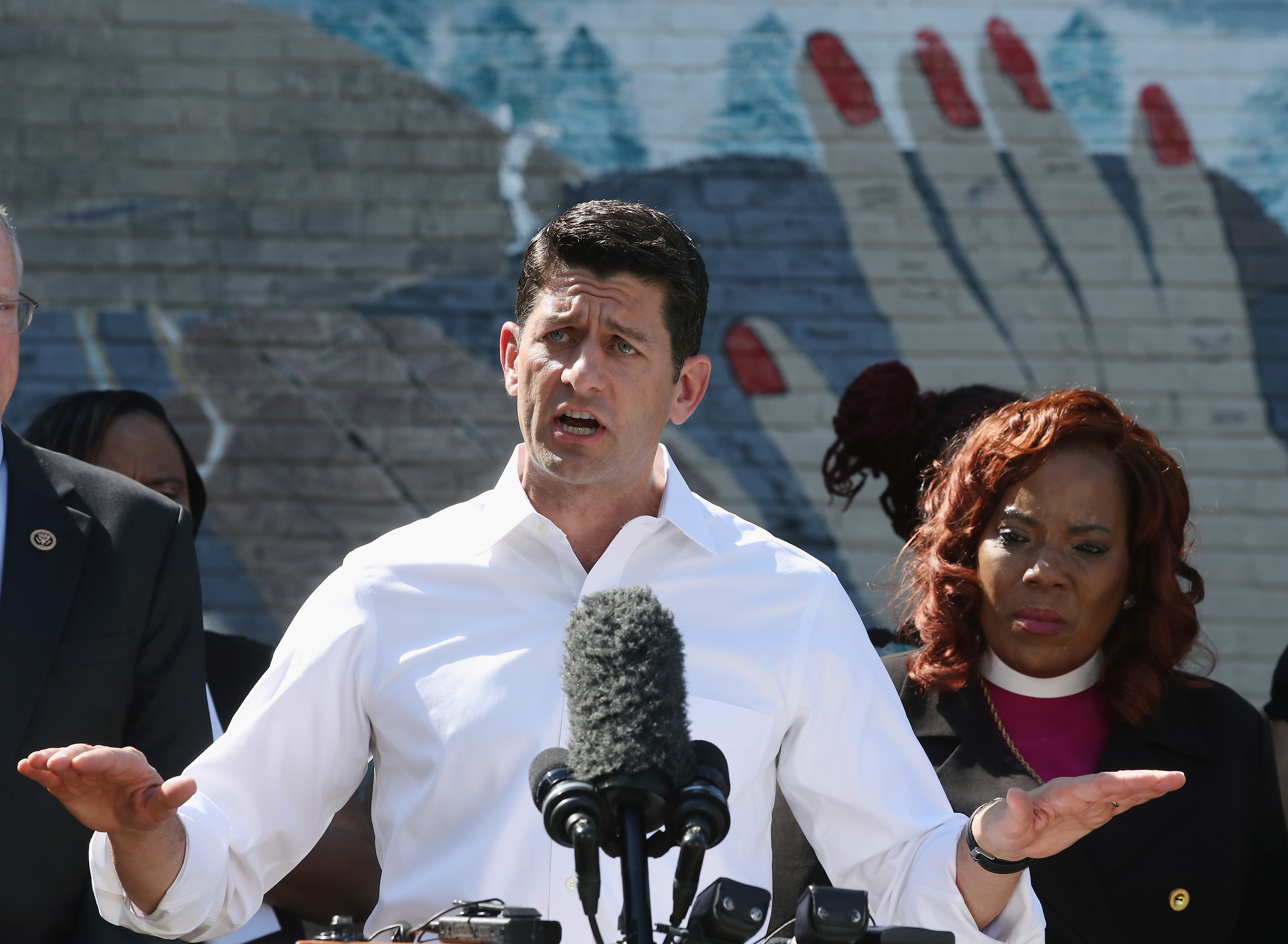 U.S. Speaker of the House Paul Ryan (R-WI), speaks while flanked by Bishop Shirley Holloway at the Graceview Apartments, June 7, 2016 in Washington, DC.