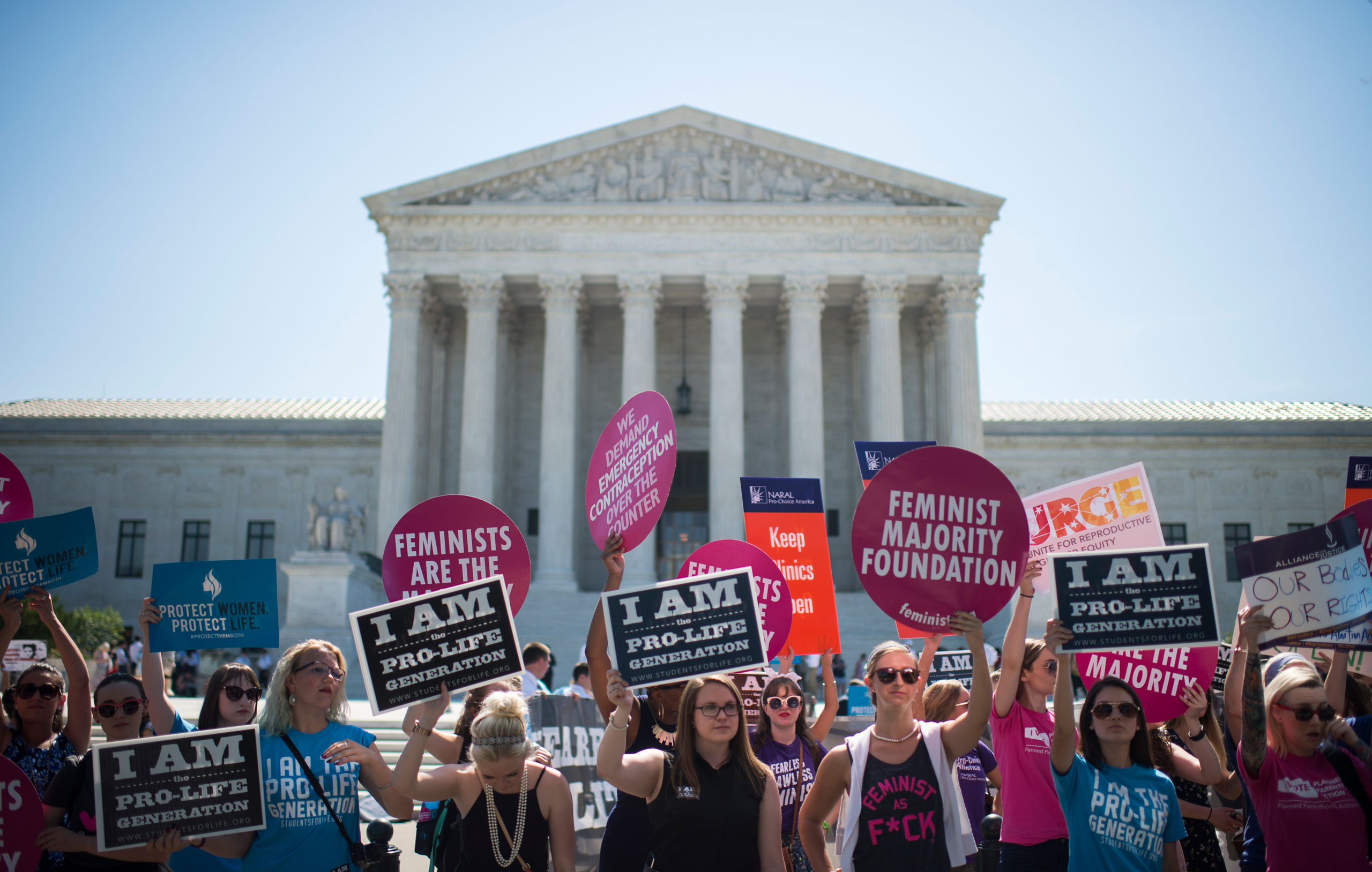 Pro-choice and pro-life demonstrators rally outside of the U.S. Supreme Court in Washington on June 20, 2016.