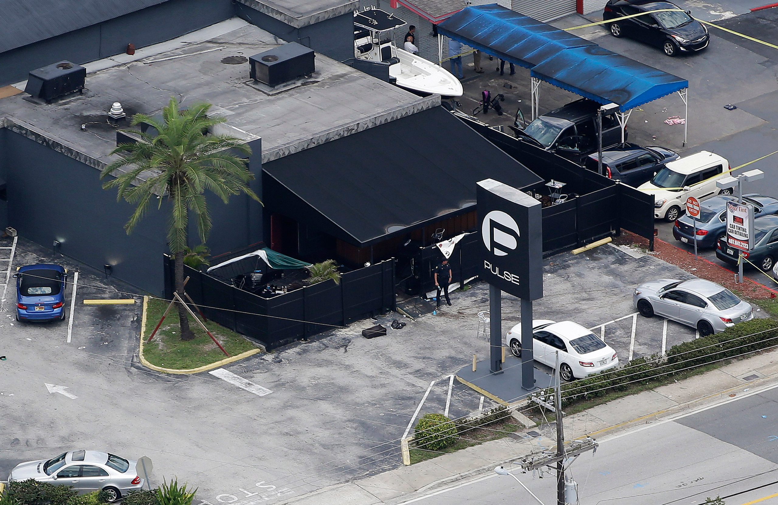 Law enforcement officials work at the Pulse Orlando nightclub following a fatal shooting in Orlando, Fla., on June 12, 2016.