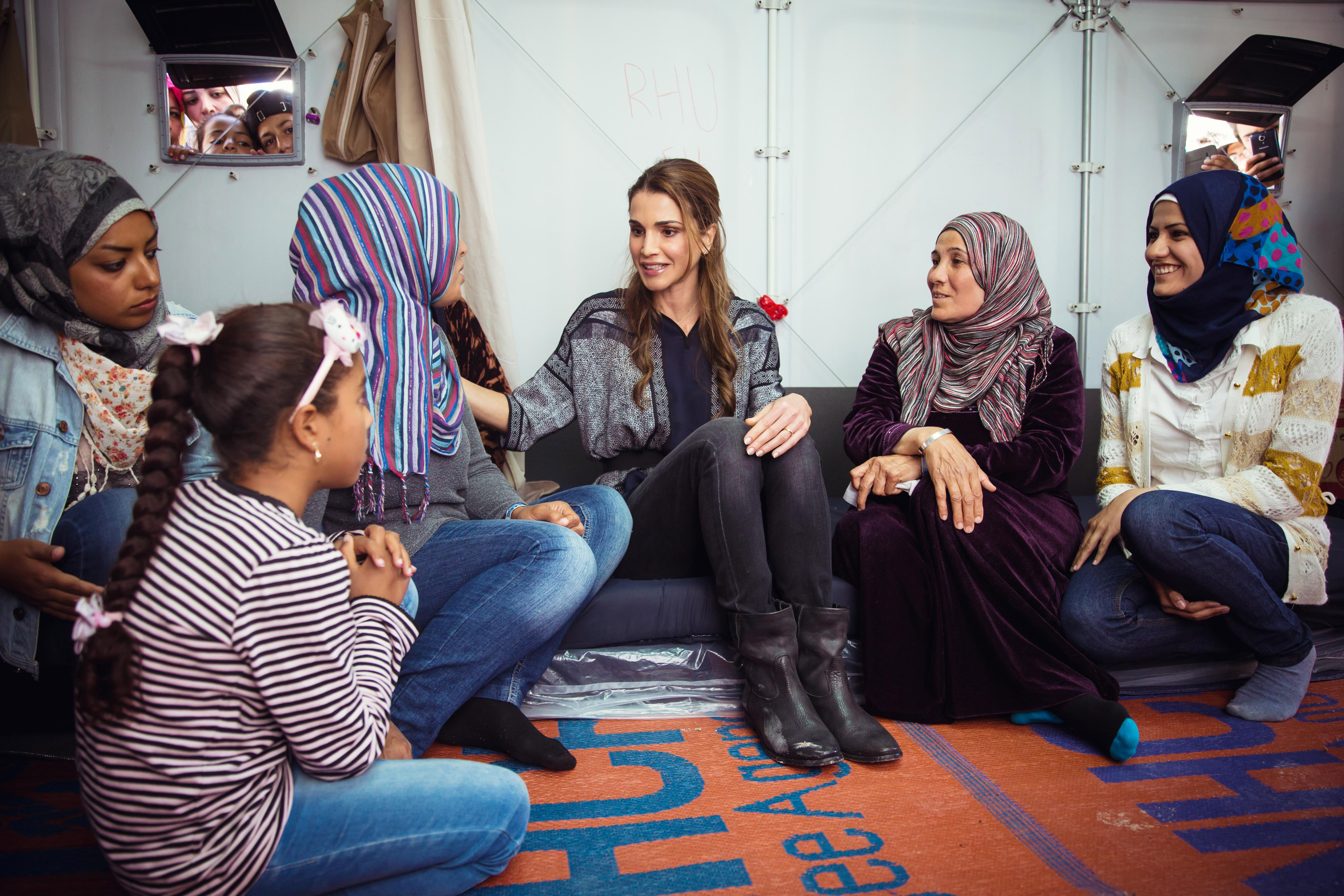 In this handout image supplied by the Office of Her Majesty Queen Rania Al Abdullah, Royal Hashemite Court, Queen Rania of Jordan meets Syrian refuges at the Karatepe municipality camp for refugees on the outskirts of Mytilene in Lesbos, Greece on April 25, 2016.