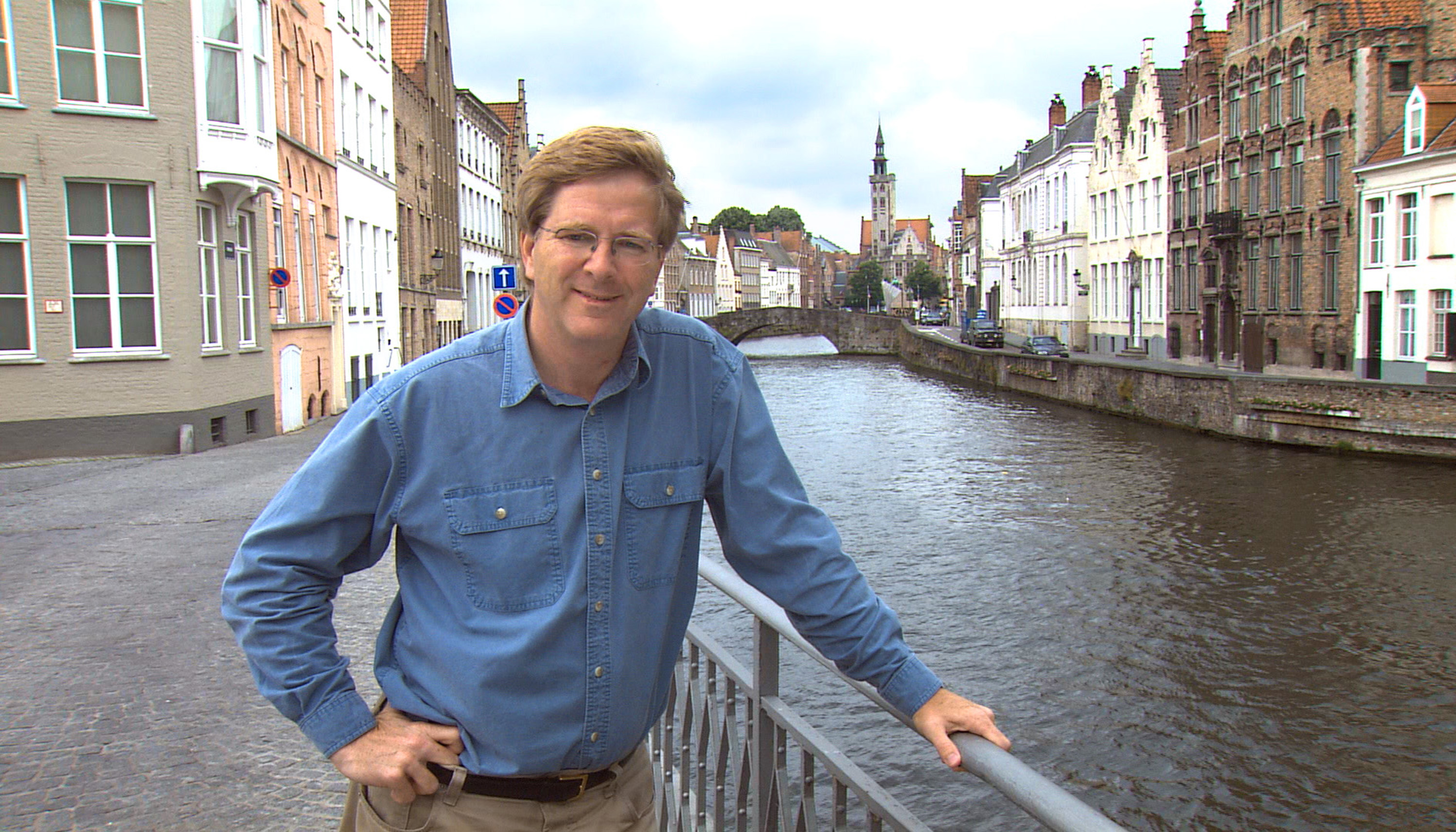 Rick Steves, in Bruges, Belgium: He spends July and August north of the Alps.