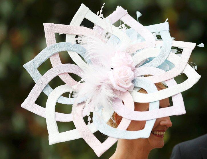 Britain Horse Racing - Royal Ascot - Ascot Racecourse - 16/6/16 Ladies Day Racegoer wears hat Reuters / Andrew Boyers