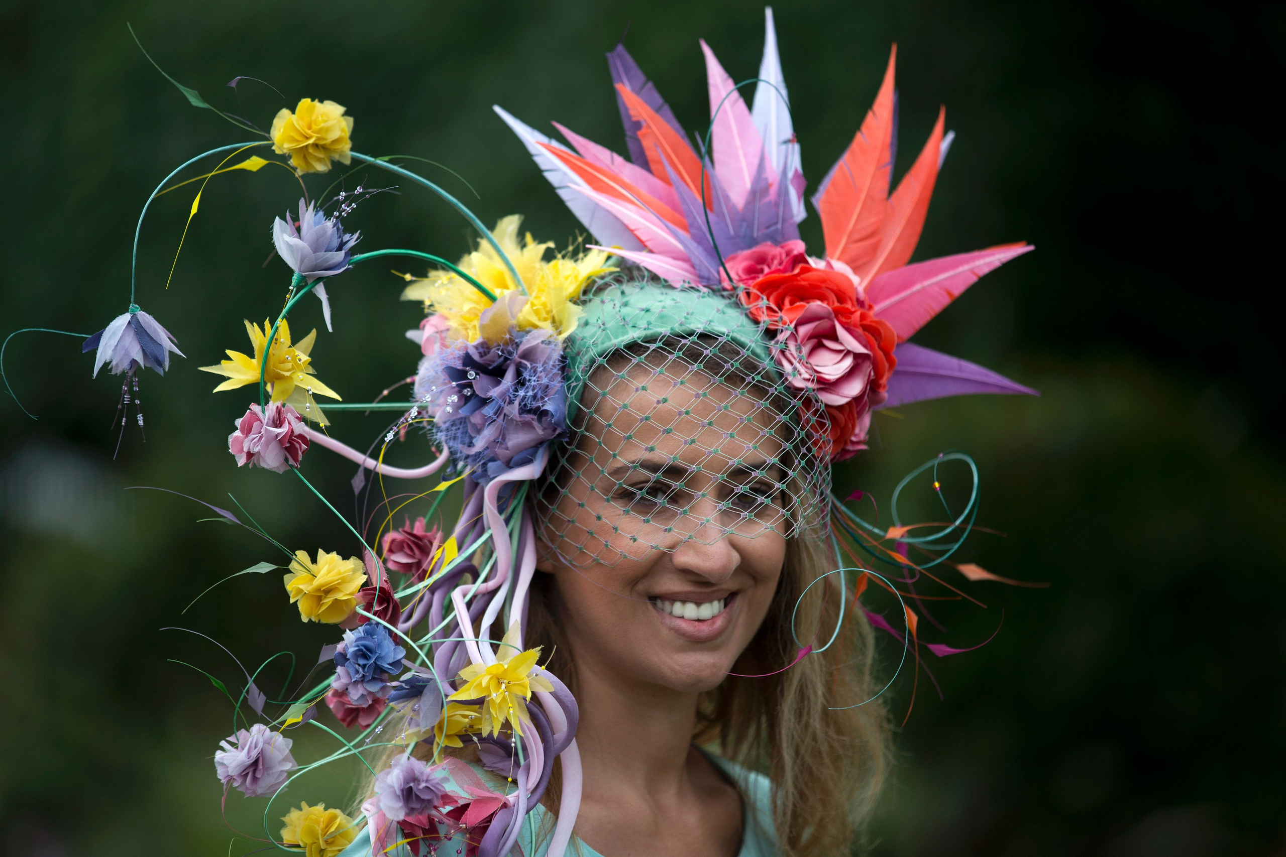 A race-goer poses for photographers on the first day of the Royal Ascot horse race meeting in Ascot, U.K., on June 14, 2016.