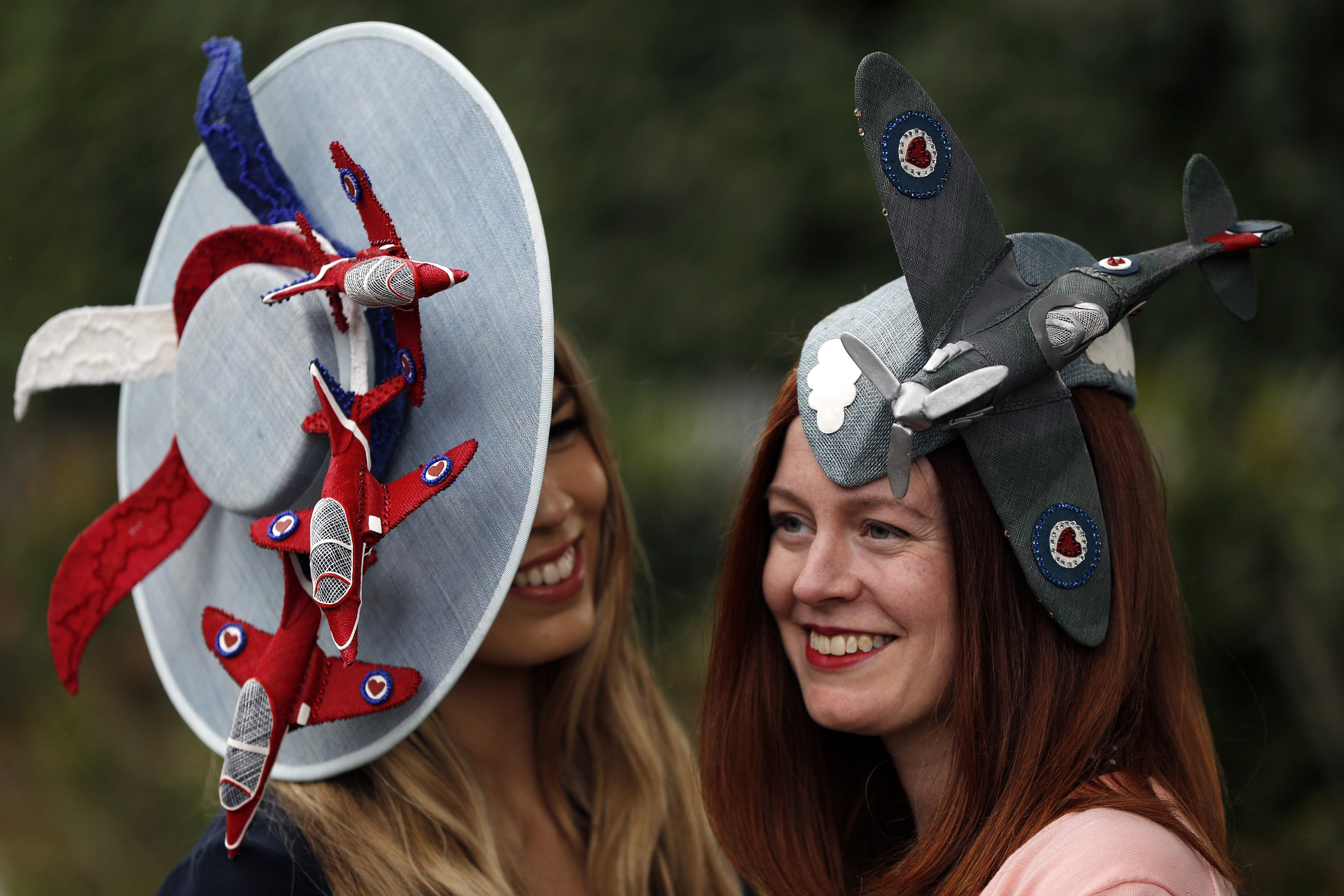 Race-goers pose for a photograph at the Royal Ascot horse race meeting in Ascot, U.K., on June 17, 2016.
