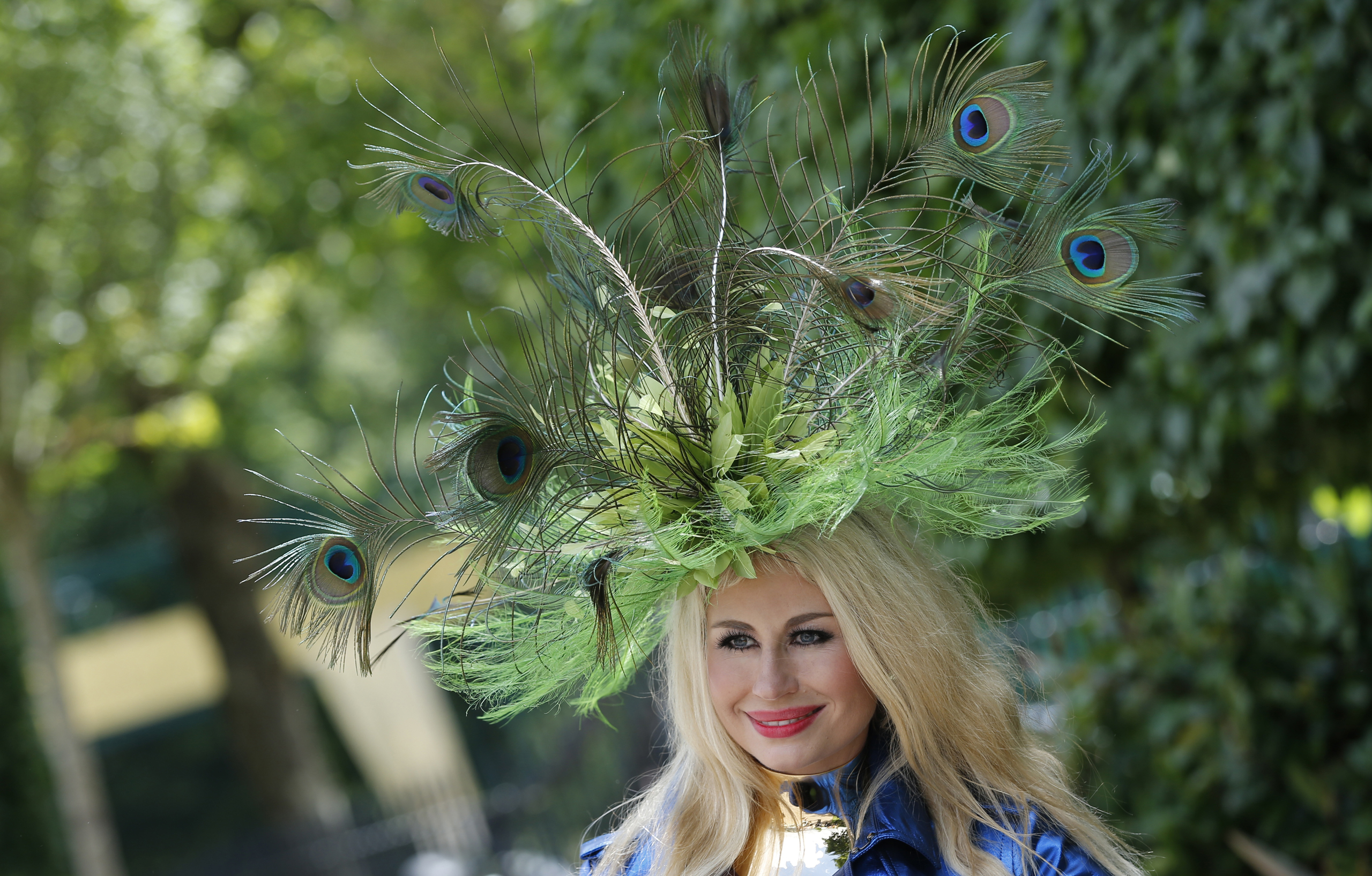 A woman wears an ornate hat made from peacock feathers on the second day of the Royal Ascot horse race meeting in Ascot, U.K., on June 15, 2016.