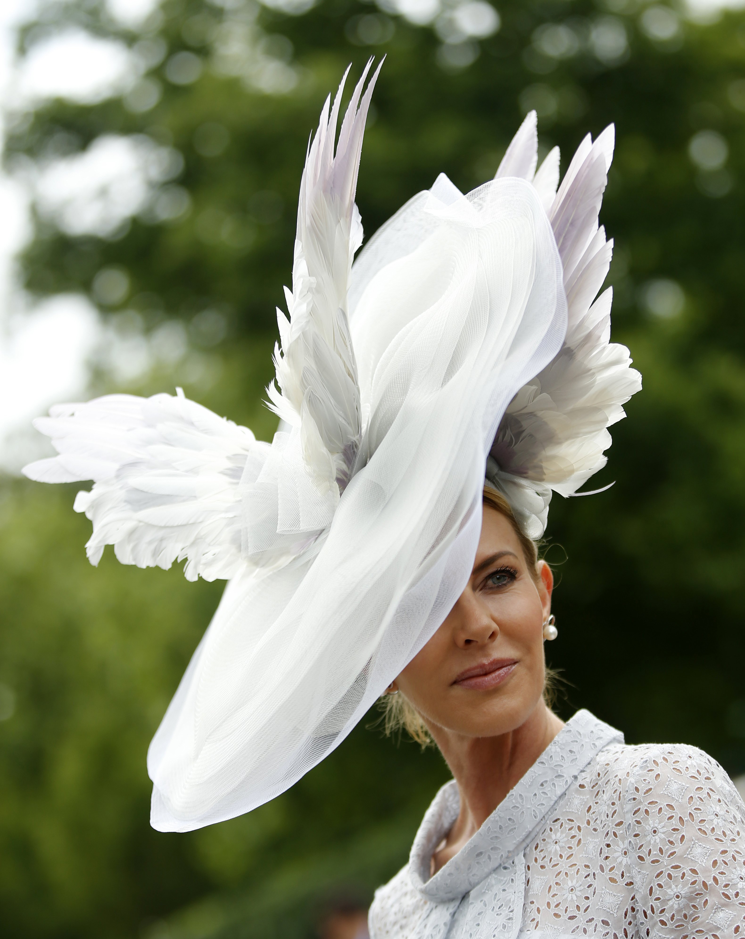 Belinda Studwick poses for photographers as she wears an ornate hat on the first day of the Royal Ascot horse race meeting in Ascot, U.K., on June 14, 2016.