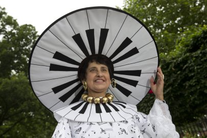 A racegoer poses for photographers on Ladies Day at the Royal Ascot horse racing meet in Ascot, west of London on June 16, 2016. / AFP PHOTO / JUSTIN TALLISJUSTIN TALLIS/AFP/Getty Images