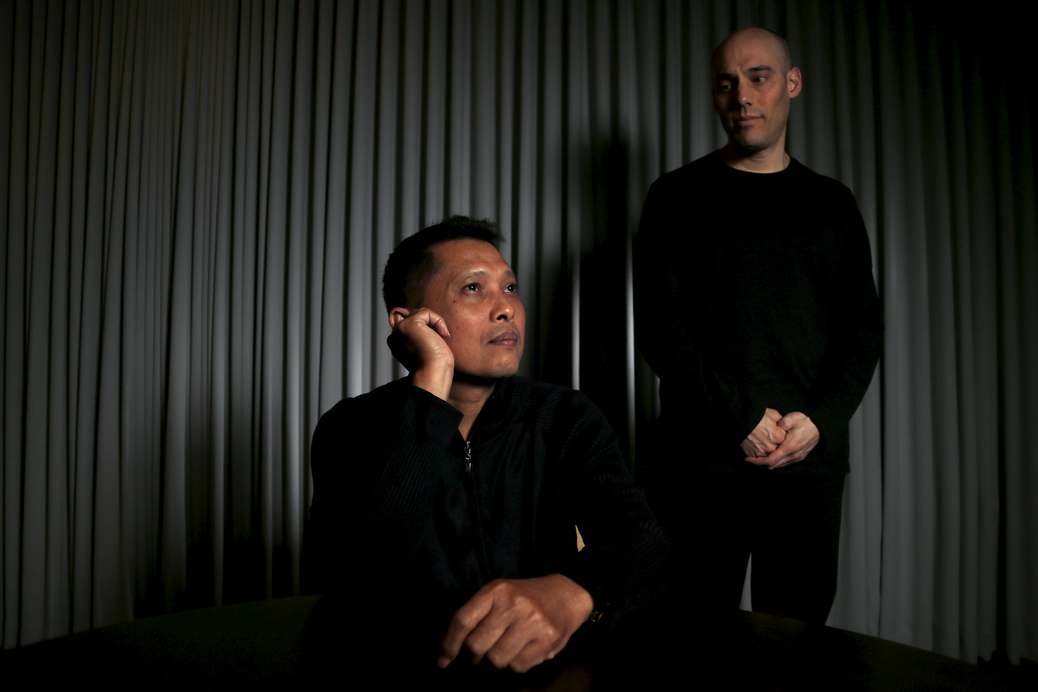 Joshua Oppenheimer, right, director of the documentary The Look of Silence, and Adi Rukun, whose brother Ramli Rukun was killed during the violence described in the documentary, pose for a portrait in Beverly Hills, Calif., on Feb. 9, 2016. Shot in Indonesia and nominated for an Oscar, the documentary is at once a source of national pride and of shame for the world's third largest democracy