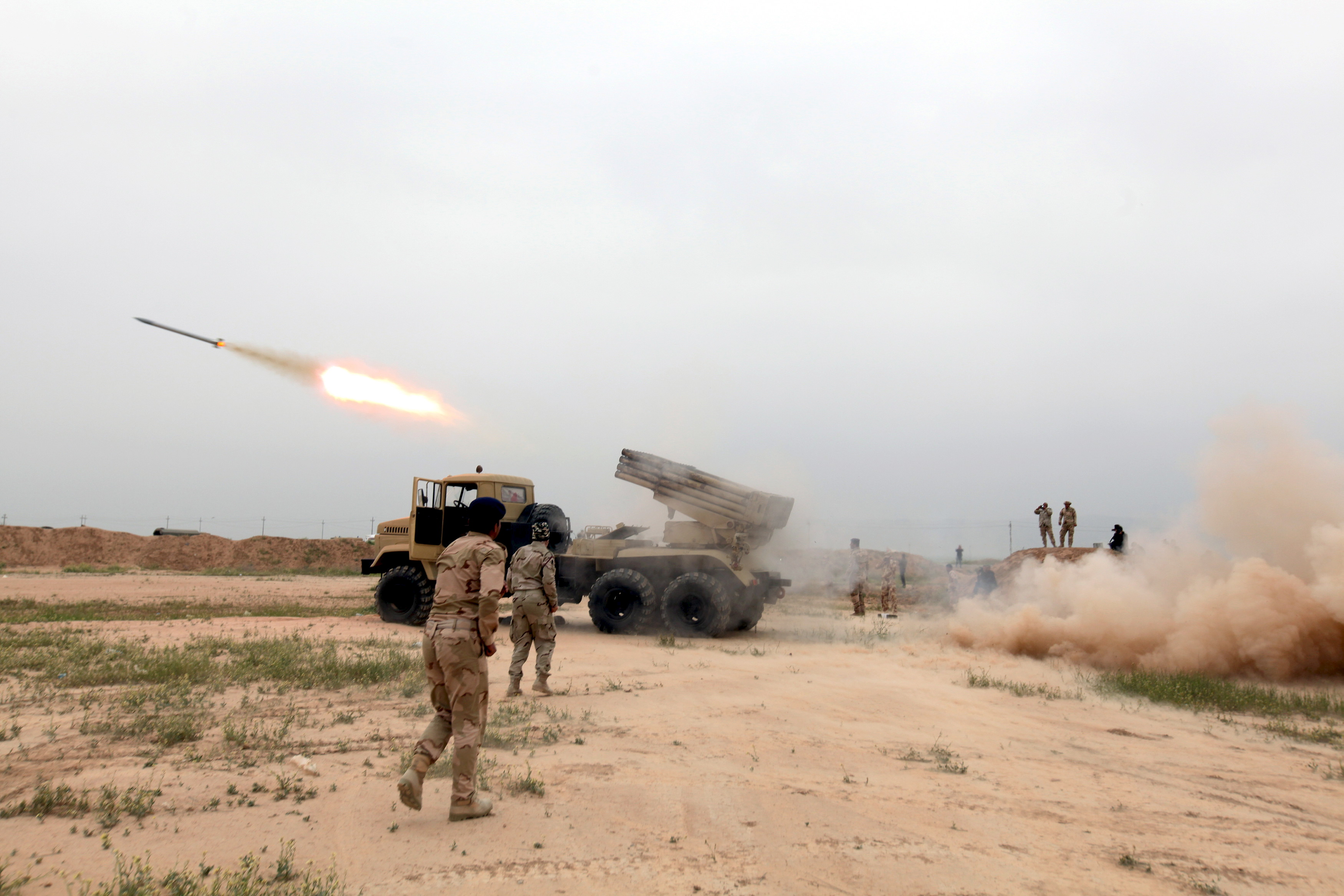 Iraqi soldiers fire a rocket toward ISIS militants on the outskirt of Makhmour, south of Mosul, Iraq, on March 25, 2016