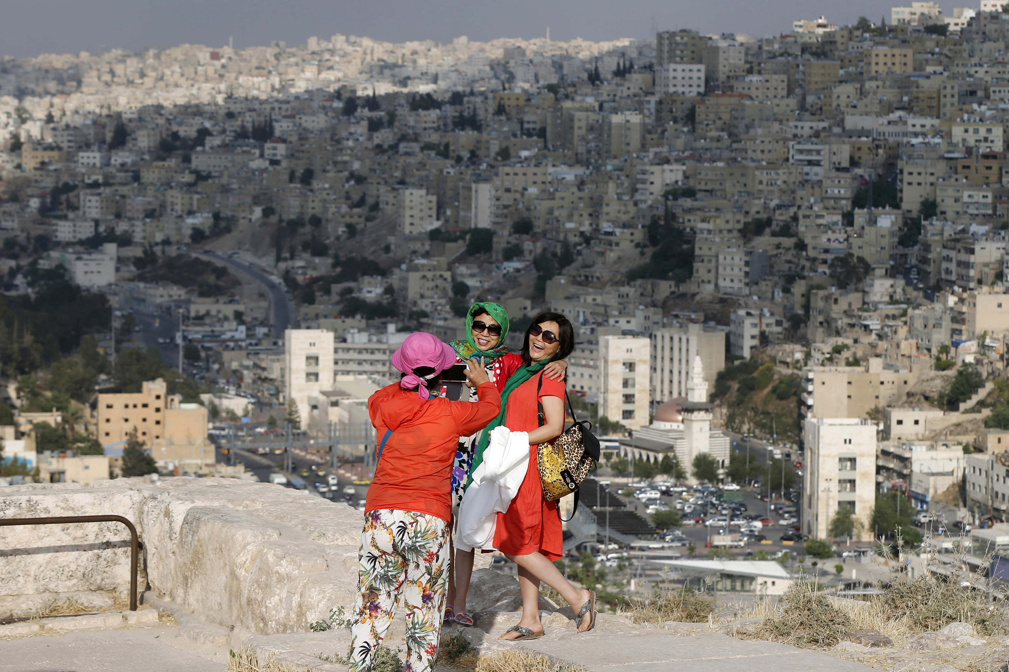 Chinese tourists take pictures during their visit to the Amman Citadel, an ancient Roman landmark in Amman, on May 23, 2016