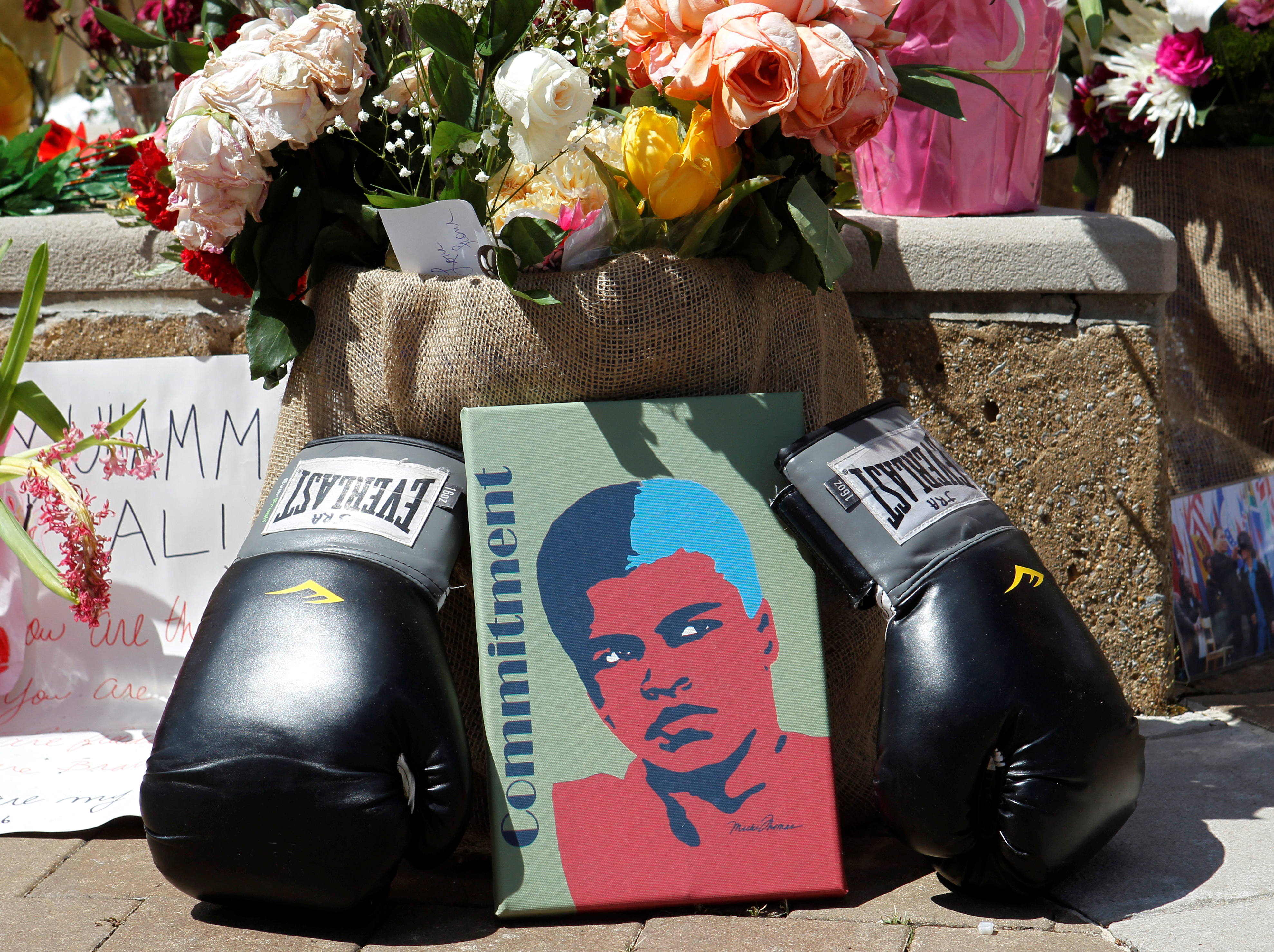 Fans of Muhammad Ali, the former world heavyweight boxing champion, leave pictures and personal mementos as they pay their respects at the Ali Center in Louisville, Kentucky, U.S. June 7, 2016.