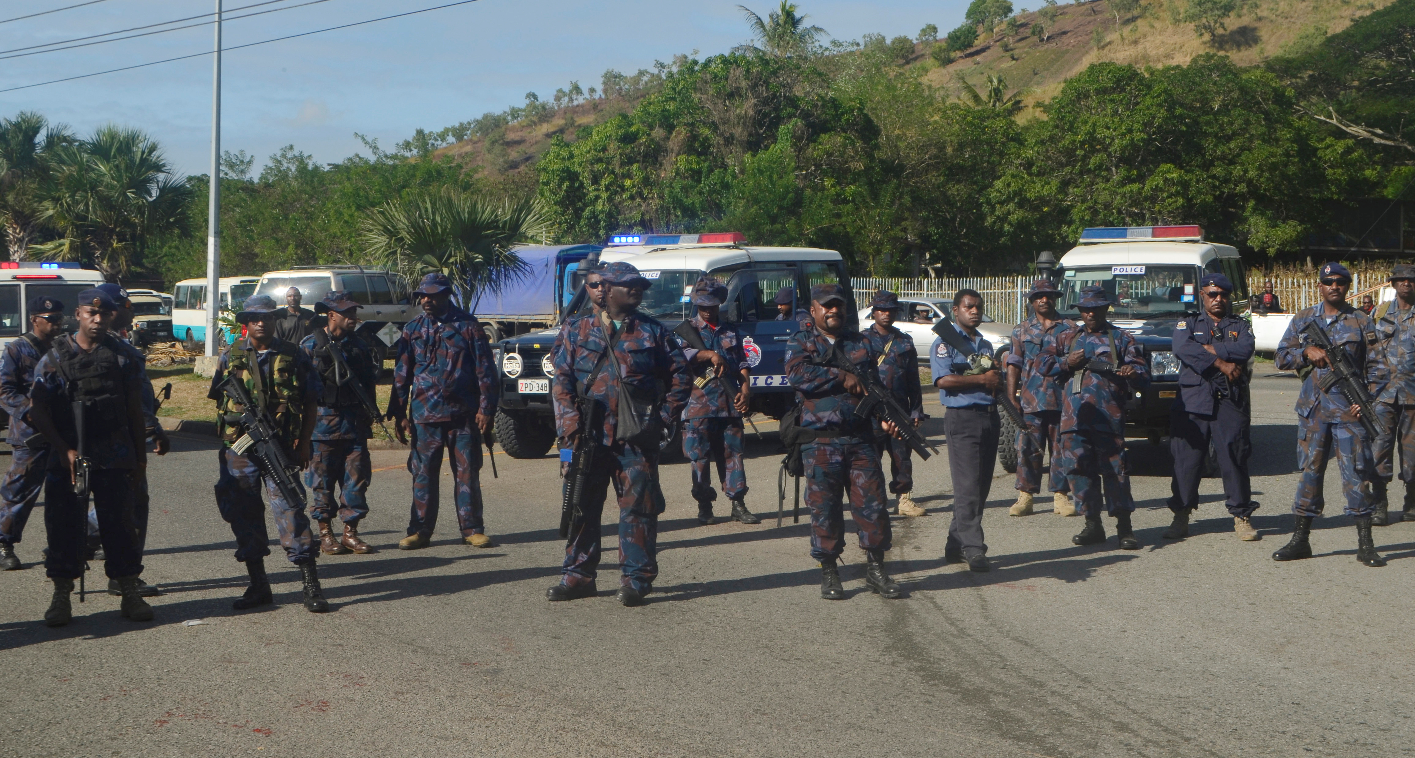 Heavily-armed police form a roadblock, preventing students from leaving the University of Papua New Guinea in Port Moresby, June 8, 2016