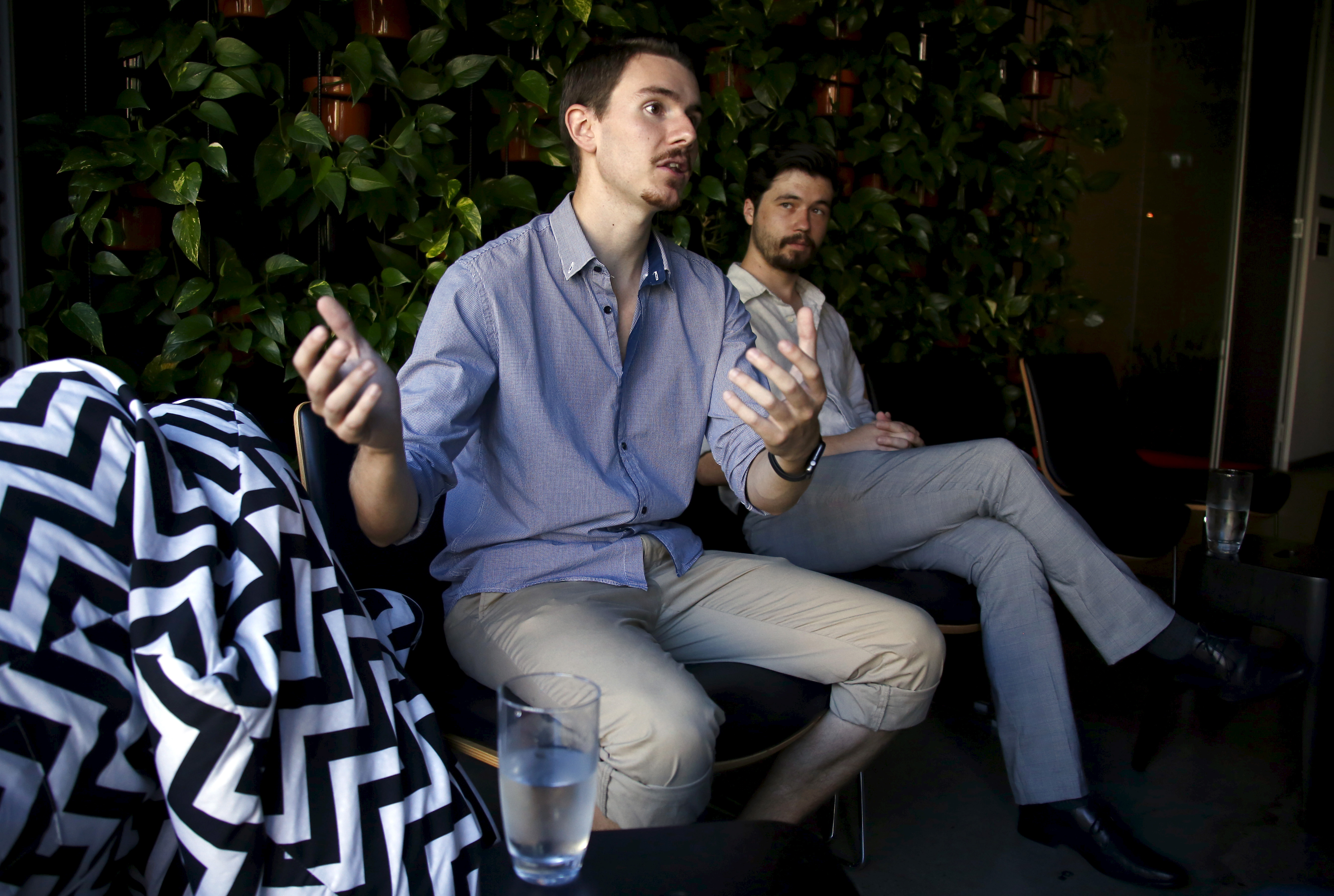 Max Kaye (R) and Nathan Spataro, co-founders of Flux, a new Australian political party, talk as they sit on couches in an office building in central Sydney, Australia, Feb. 13, 2016