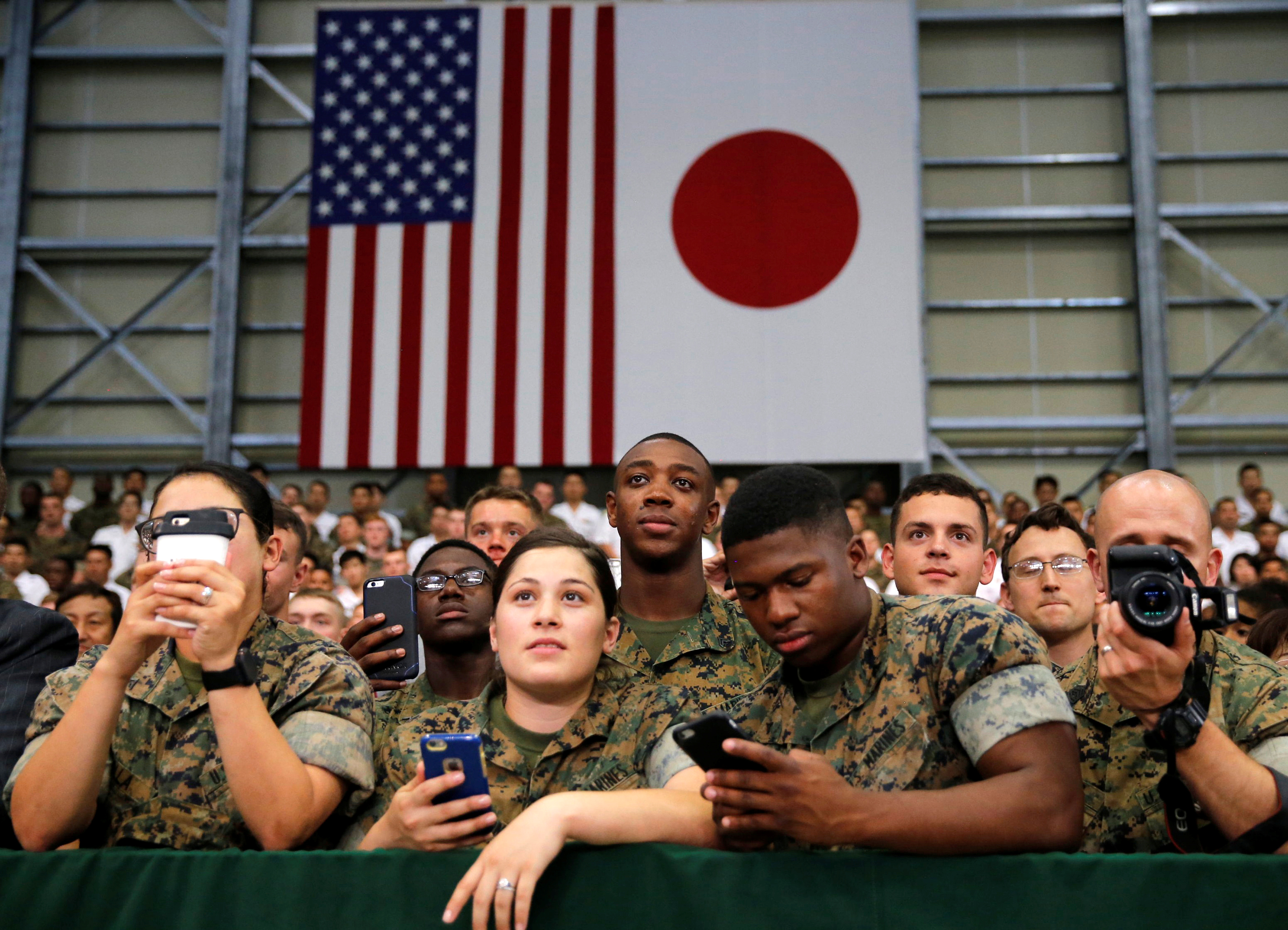 U.S. and Japan Self-Defence Forces soldiers listen a speech by U.S. President Barack Obama during his visit at Iwakuni Marine Corps Air Station, en route to Hiroshima, Japan, on May 27, 2016