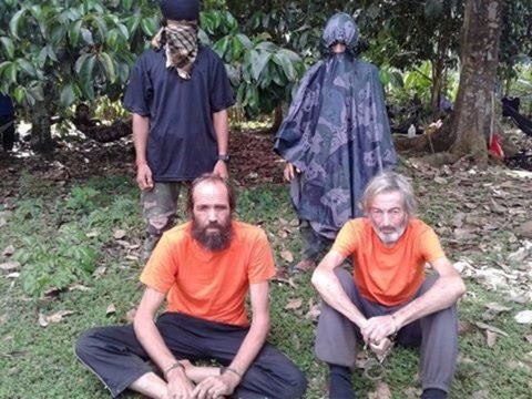 Hostages Canadian national Robert Hall, right, and Norwegian national Kjartan Sekkingstad, left, are seen in this undated picture released to local media in Jolo island in southern Philippines