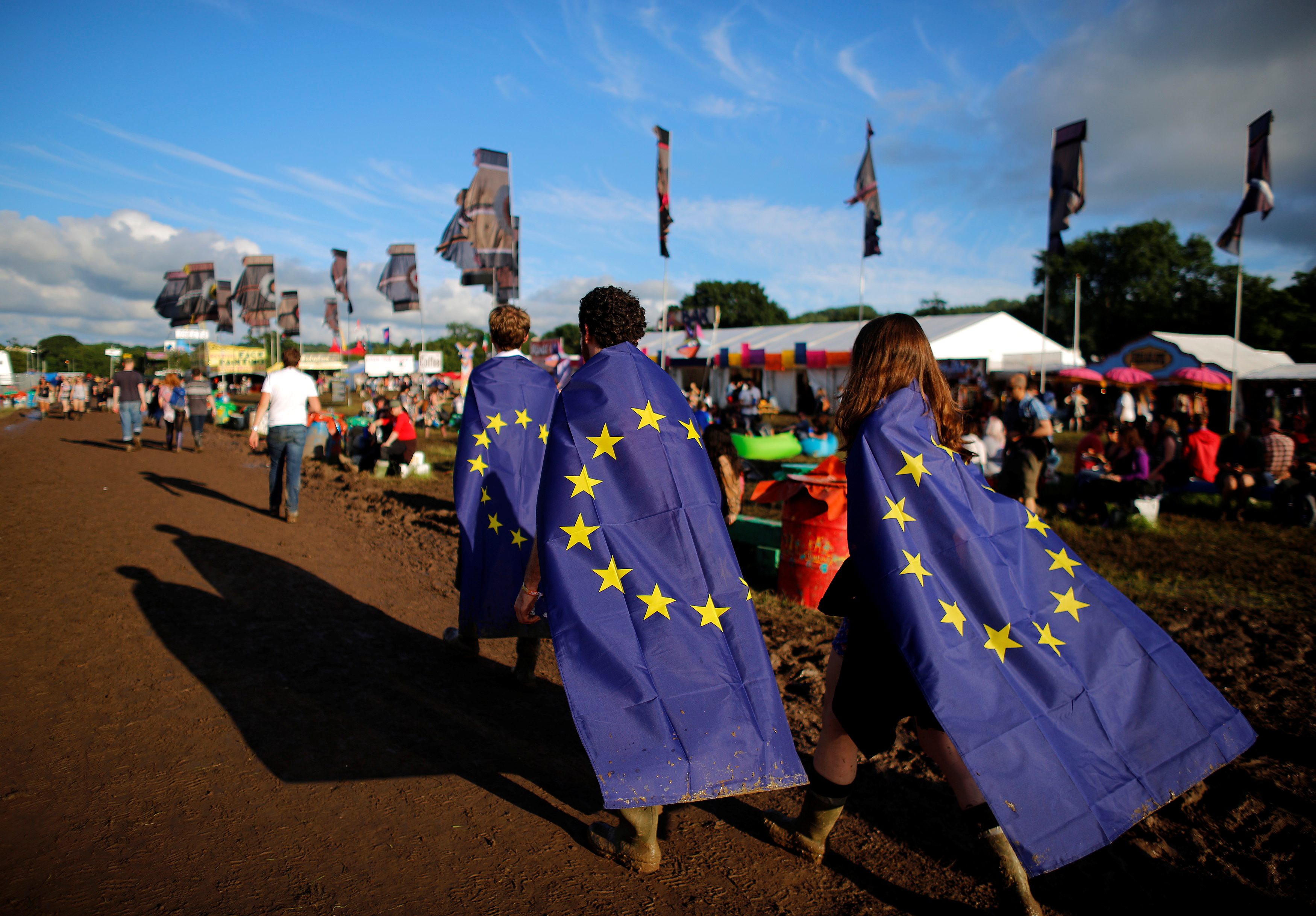 Revelers wrapped in European Union flags walk at Worthy Farm in Somerset during the Glastonbury Festival, Britain, June 22, 2016