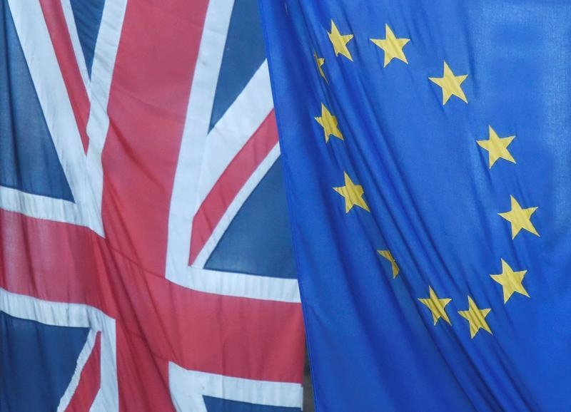 A U.K. flag flies next to the flag of the European Union in Westminster, London, on June 24, 2016