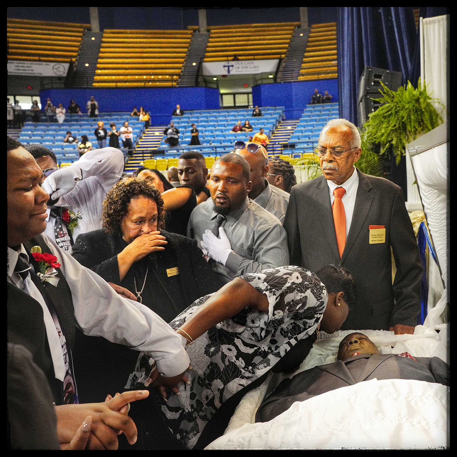 Baton Rouge, La.: Quinyetta McMillon says her final goodbye to Alton Sterling with a kiss as their 15-year-old son Cameron looks on with tears. They are flanked by relatives who rushed to the front to say goodbye for the final time. July 15, 2016.From  Lessons From a Tragic Month in America