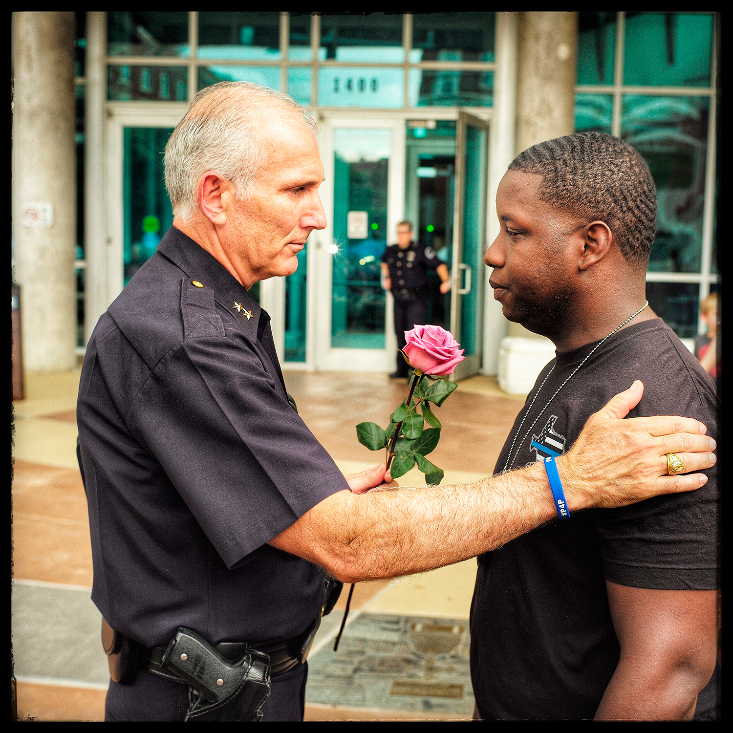 Assistant Chief of Police Gary Tittle comforts a young man in front of the police station where a memorial was erected for people to come and grieve. July 9, 2016, Dallas, Texas.From  How One Photo Captured Both Unity and Division in America