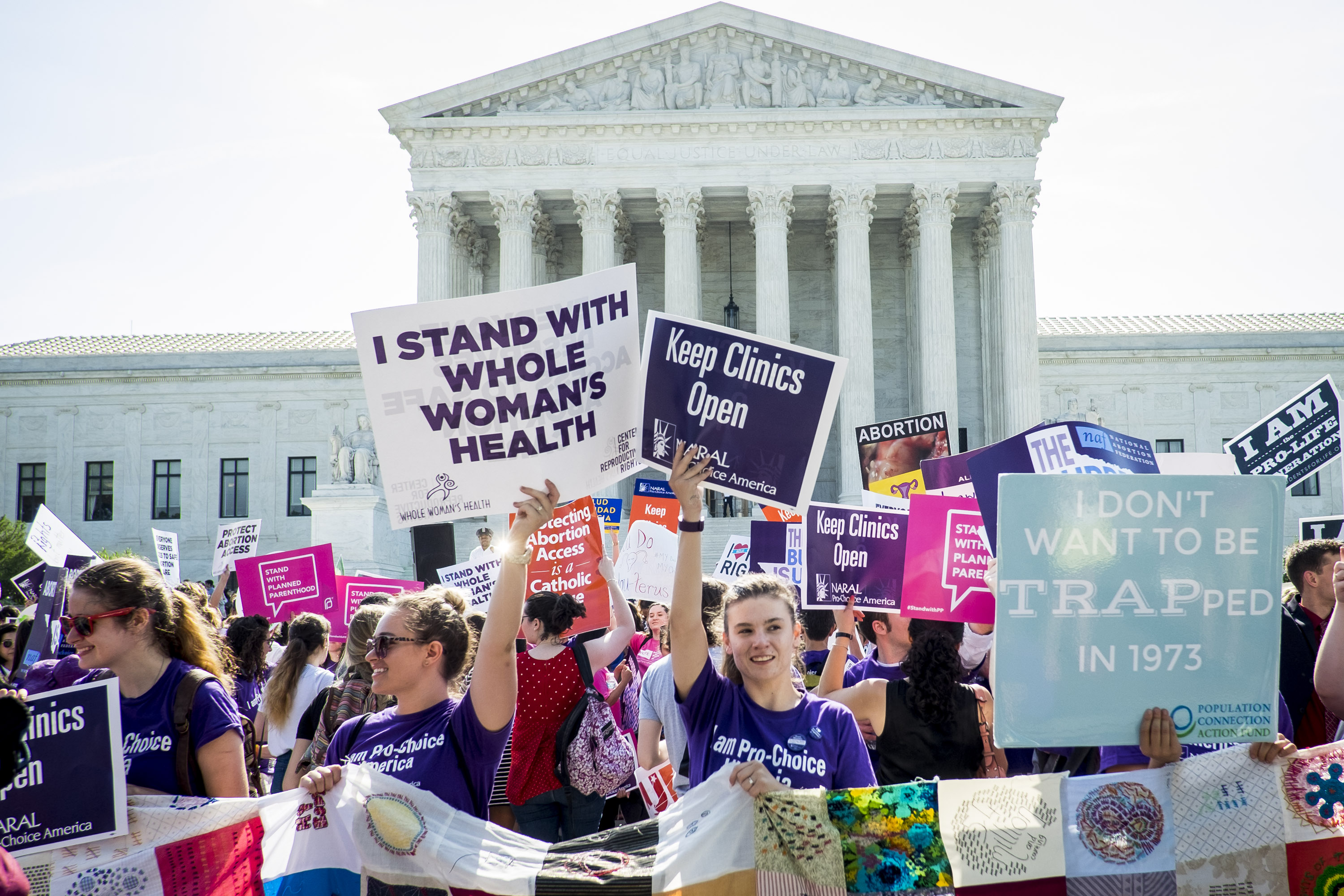 Pro-choice and pro-life activists demonstrate on the steps of the United States Supreme Court in Washington, D.C. on June 27, 2016.