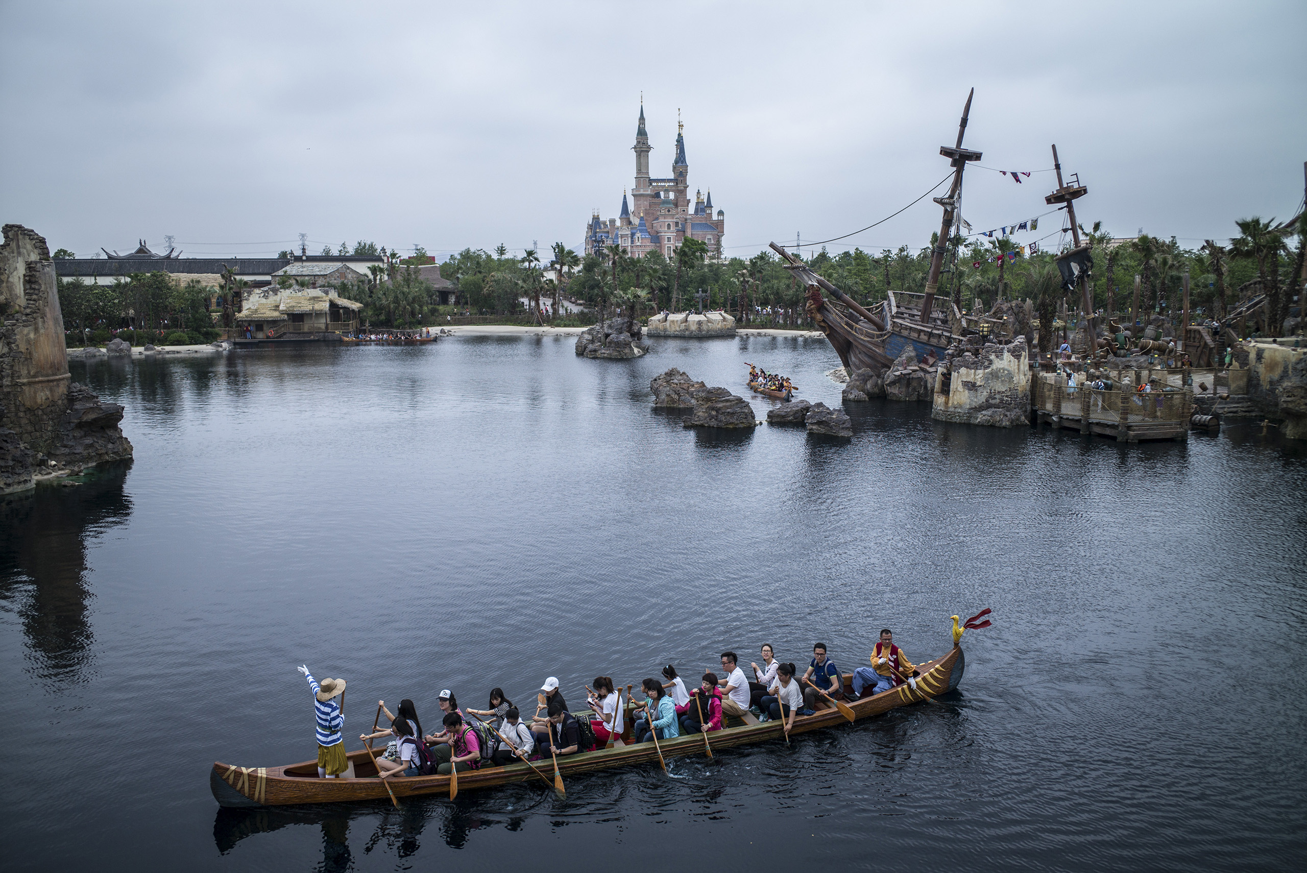 Visitors take the canoe ride at Treasure Cove during a preview of Shanghai Disneyland on June 10, 2016, in Shanghai