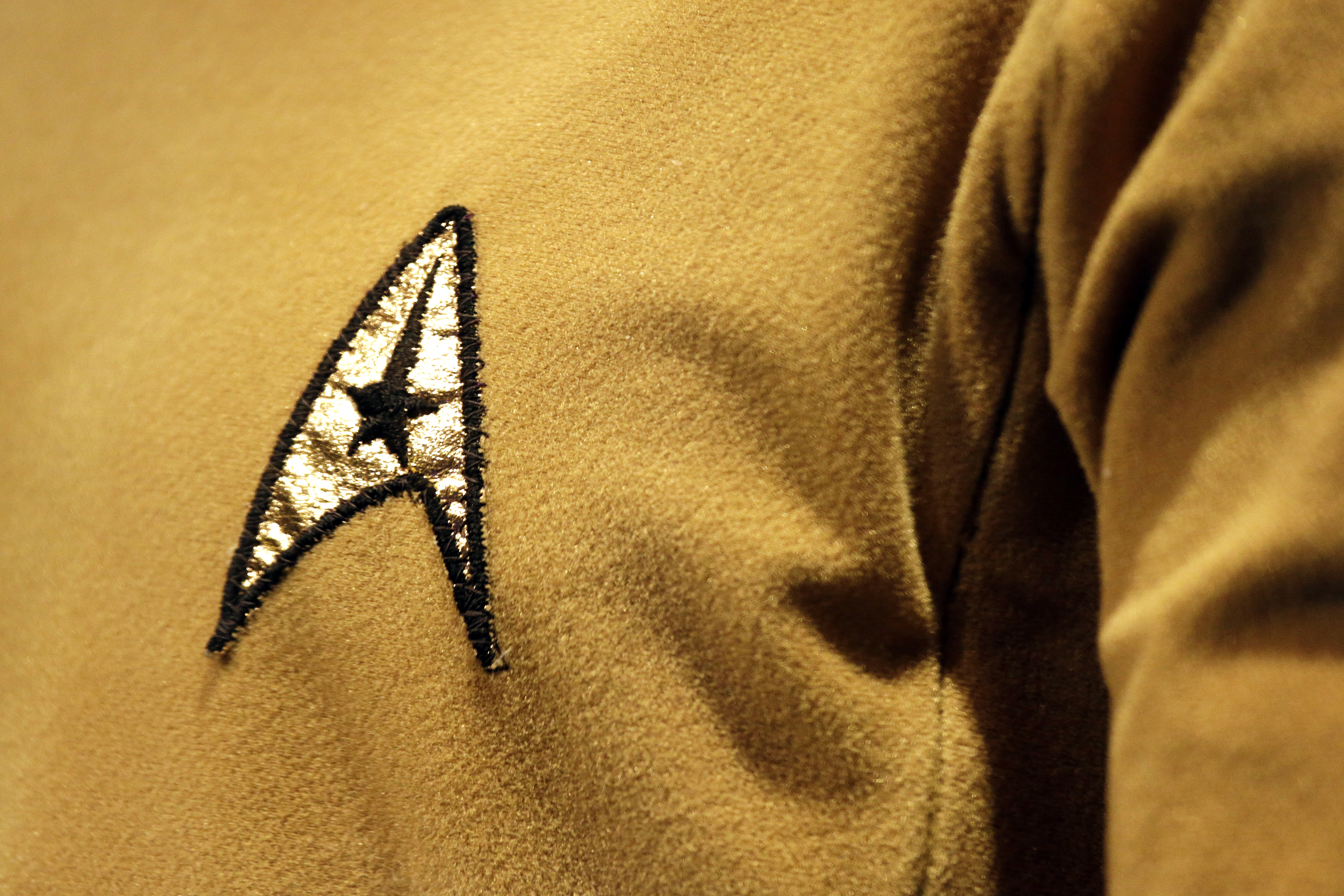 A Starfleet insignia appears on the original tunic worn by Capt. James T. Kirk, played by William Shatner at the EMP Museum, in Seattle, May 18, 2016.