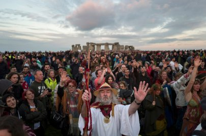 Revellers celebrate the summer solstice at Stonehenge on Salisbury Plain in southern England, on June 21, 2016.