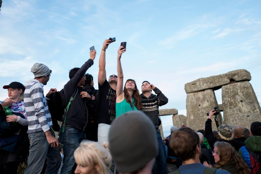 Revellers celebrate the longest day of the year at Stonehenge on Salisbury Plain in southern England, June 20, 2016.