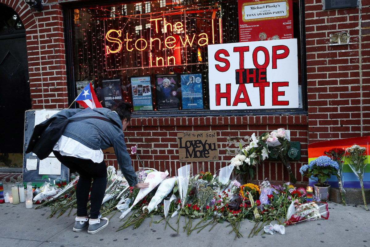 Flowers are placed at a make-shift memorial in front of the Stonewall Inn in New York City, where a vigil was held following the massacre that occurred at a gay Orlando nightclub on June 12, 2016