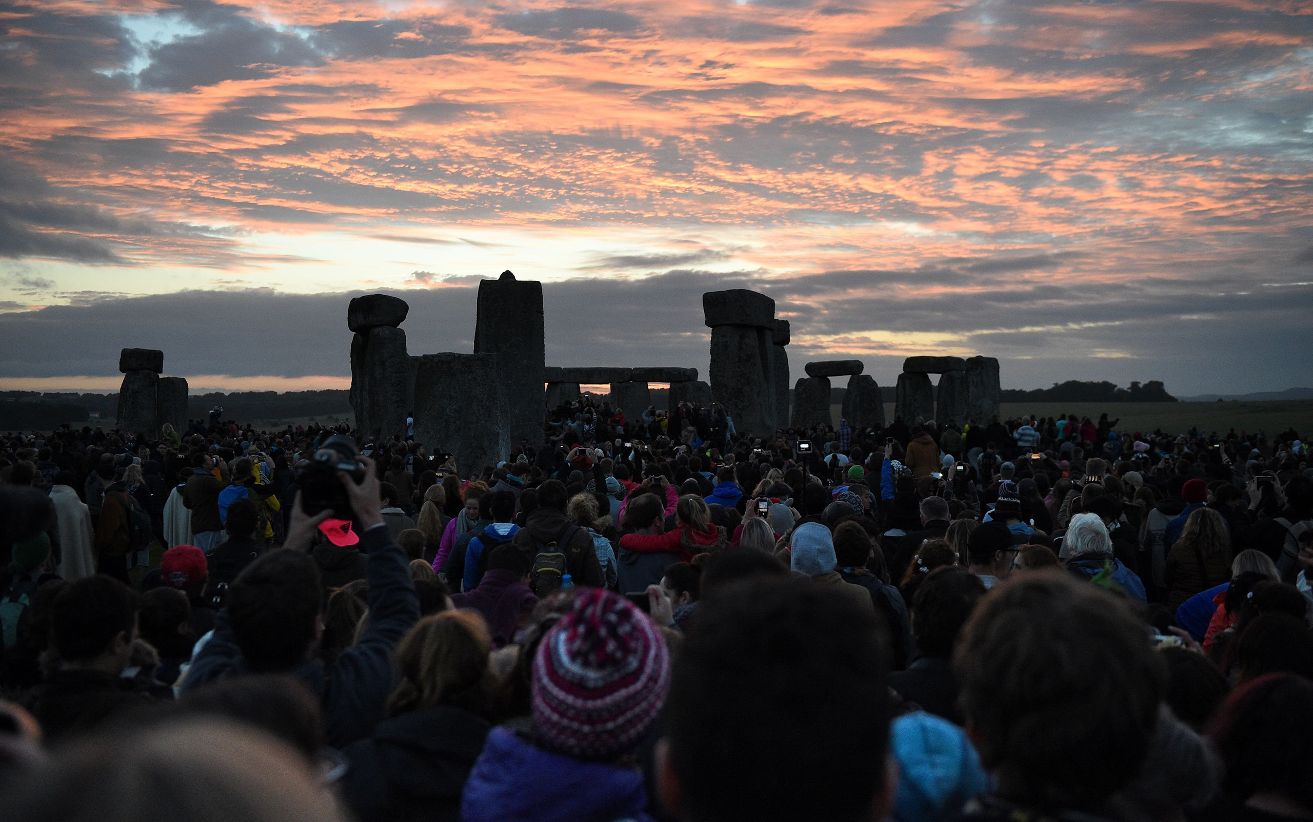 People gather at Stonehenge in Wiltshire to see in the new dawn during this year's Summer Solstice, June 21, 2016.