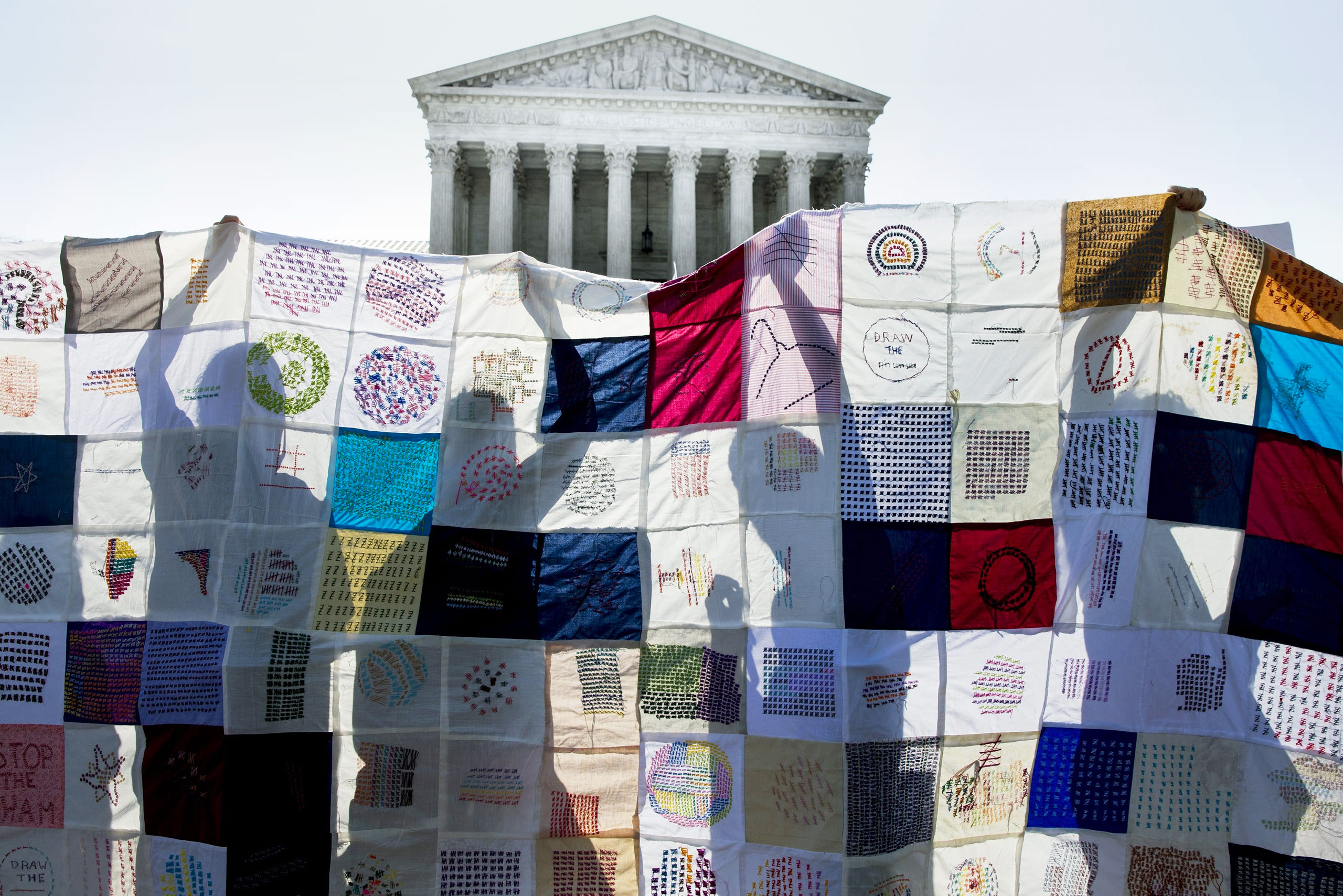 Pro-choice activists rally outside the court June27 after it ruled against a Texas abortion law
