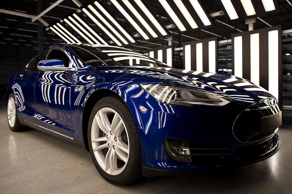 A Tesla Model S automobile stands in a light tunnel during quality control checks ahead of European shipping from the Tesla Motors Inc. factory in Tilburg, Netherlands, on Oct. 8, 2015.