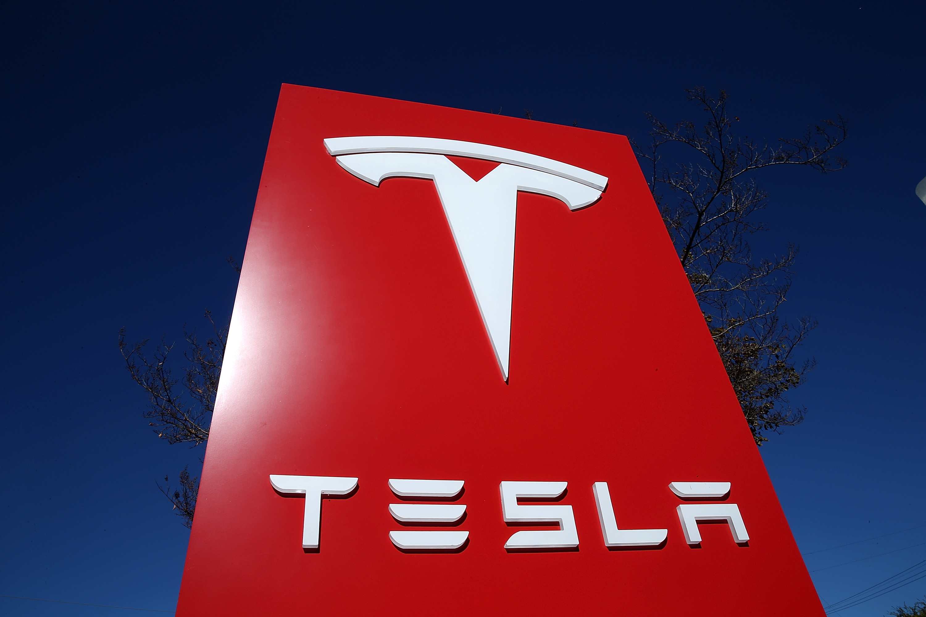 A sign is posted at a Tesla showroom on Nov. 5, 2013 in Palo Alto, California.