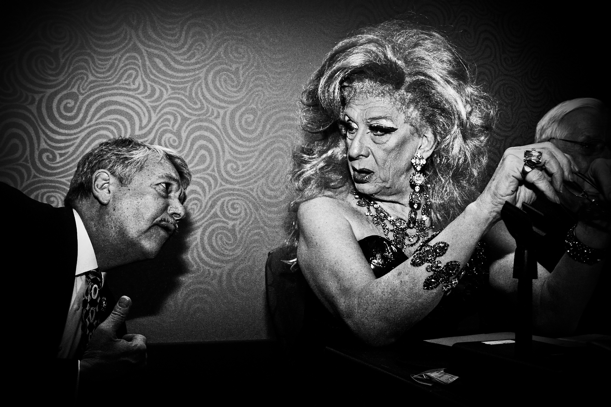 Jack-e Edwards gives Mike Dumoulin a bewildered look at The Imperial Sovereign Court of Seattle's Coronation, an annual drag celebration, at the Renaissance Ballroom on Feb. 19, 2011, in Seattle.