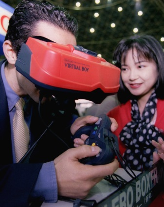 """A visitor to a Tokyo software exhibition samples Nintendo's 32-bit """"Virtual Boy"""" three dimensional virtual reality video game system on Nov. 15, 1994."""