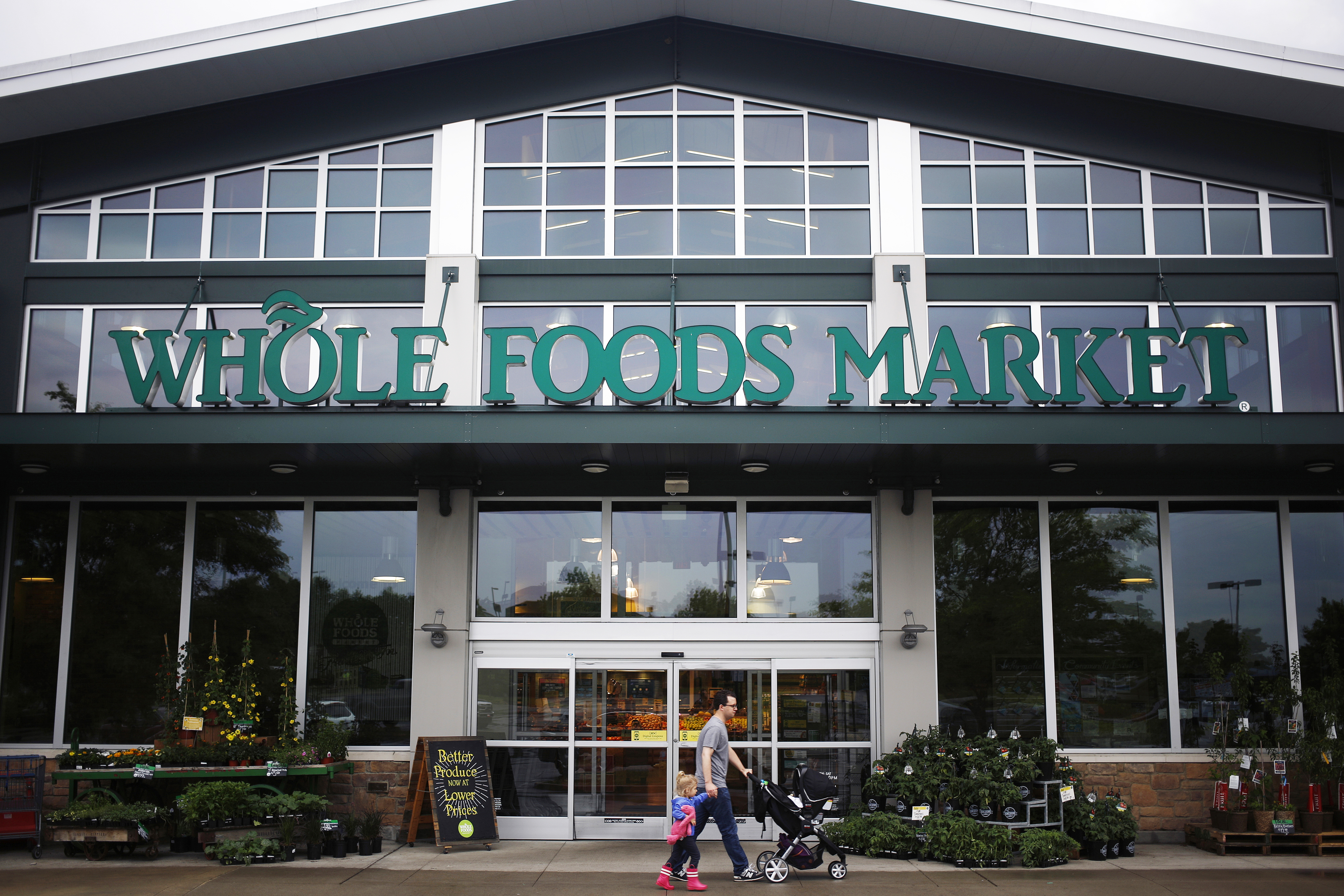 A shopper walks in front of a Whole Foods store in Franklin, Tenn. on April 30, 2016.