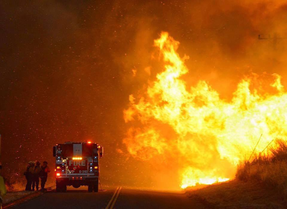 Lompoc City Firefighters in front of a wall of flames from the Sherpa Fire some 30 miles north of Goleta, Calif., on June 17, 2016.