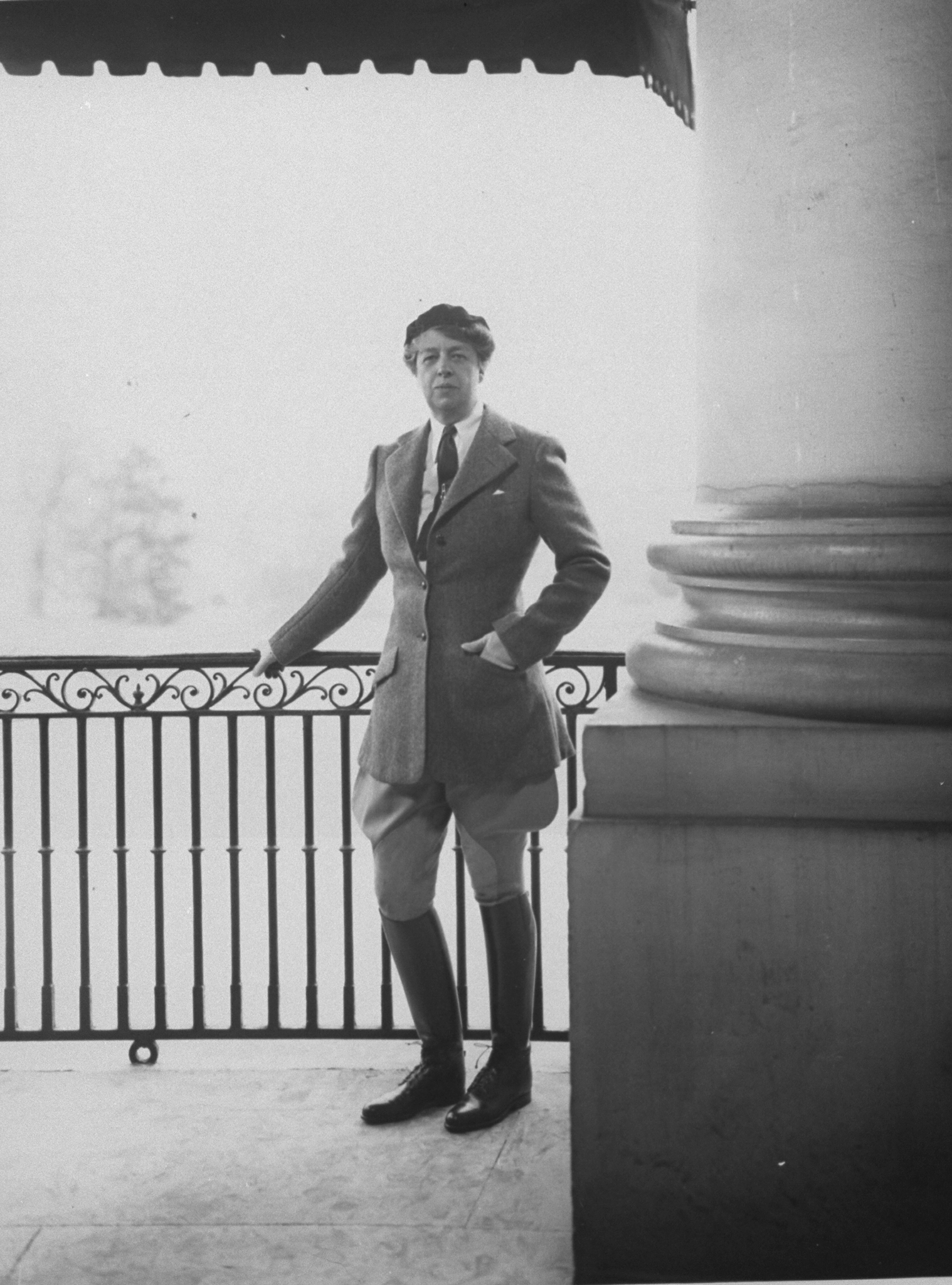First Lady Eleanor Roosevelt wearing riding breeches and boots posing for photo on the East Portico of the White House in 1934.