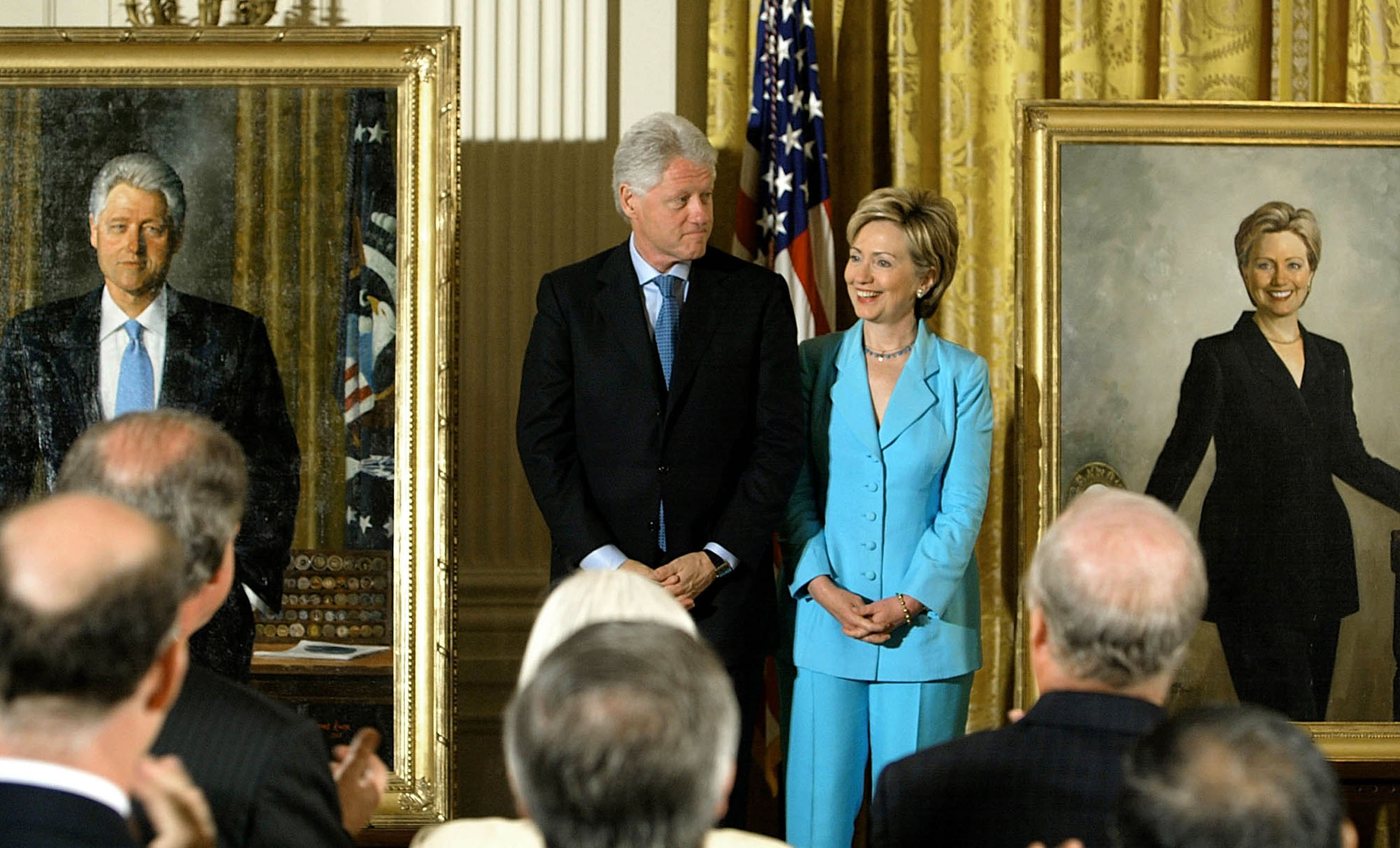 Former U.S. President Bill Clinton and his wife U.S. Senator Hillary Clinton look at the newly unveiled Clinton portraits in the East Room of the White House in Washington, D.C., June 14, 2004.