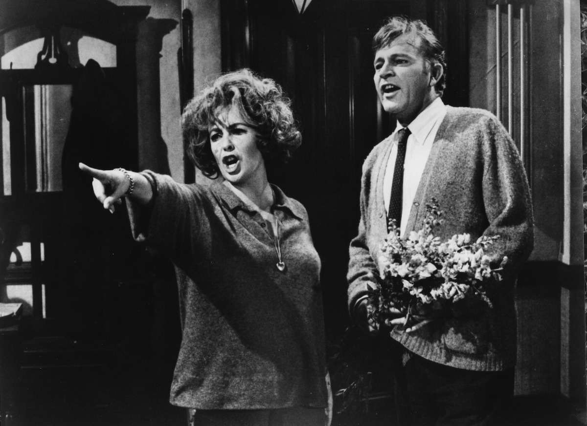 Elizabeth Taylor angrily points as Richard Burton looks on in a scene from the  Warner Bros movie  Who's Afraid of Virginia Woolf ?