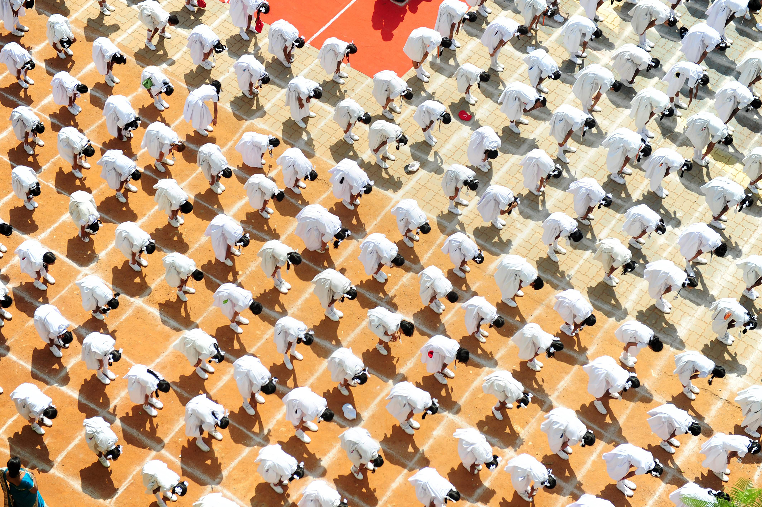 Four thousand and one Indian schoolchildren participate in a yoga session on the eve of International Yoga Day at a school in Chennai, India, on June 20, 2016.
