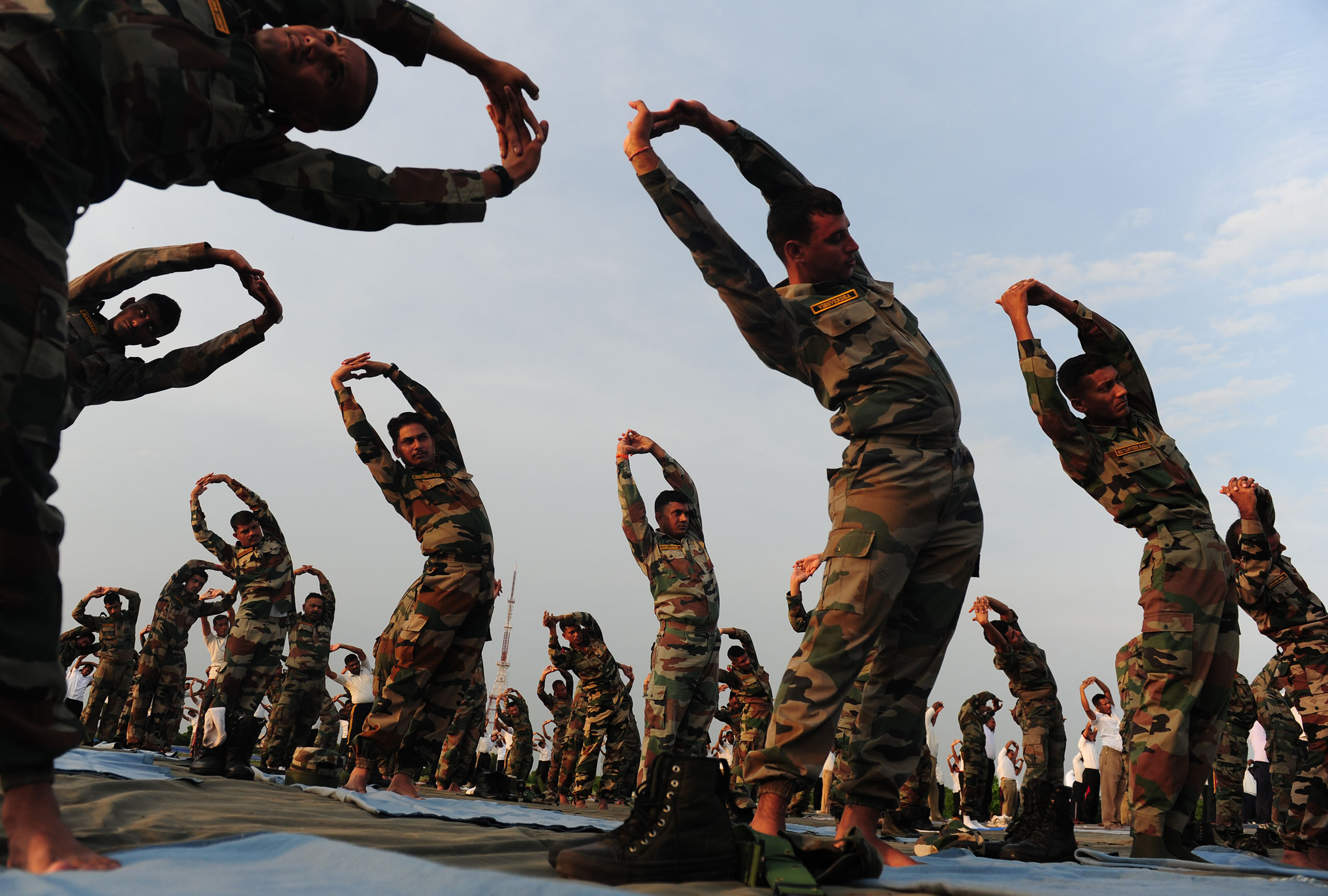 Indian Army soldiers participate in a yoga demonstration on International Yoga Day in Chennai, India, on June 21, 2016.