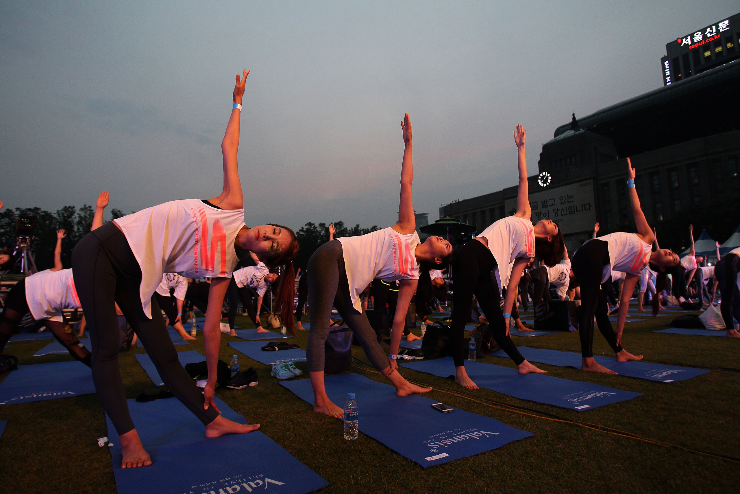 People perform yoga to mark International Day of Yoga in Seoul, South Korea, on June 21, 2016.
