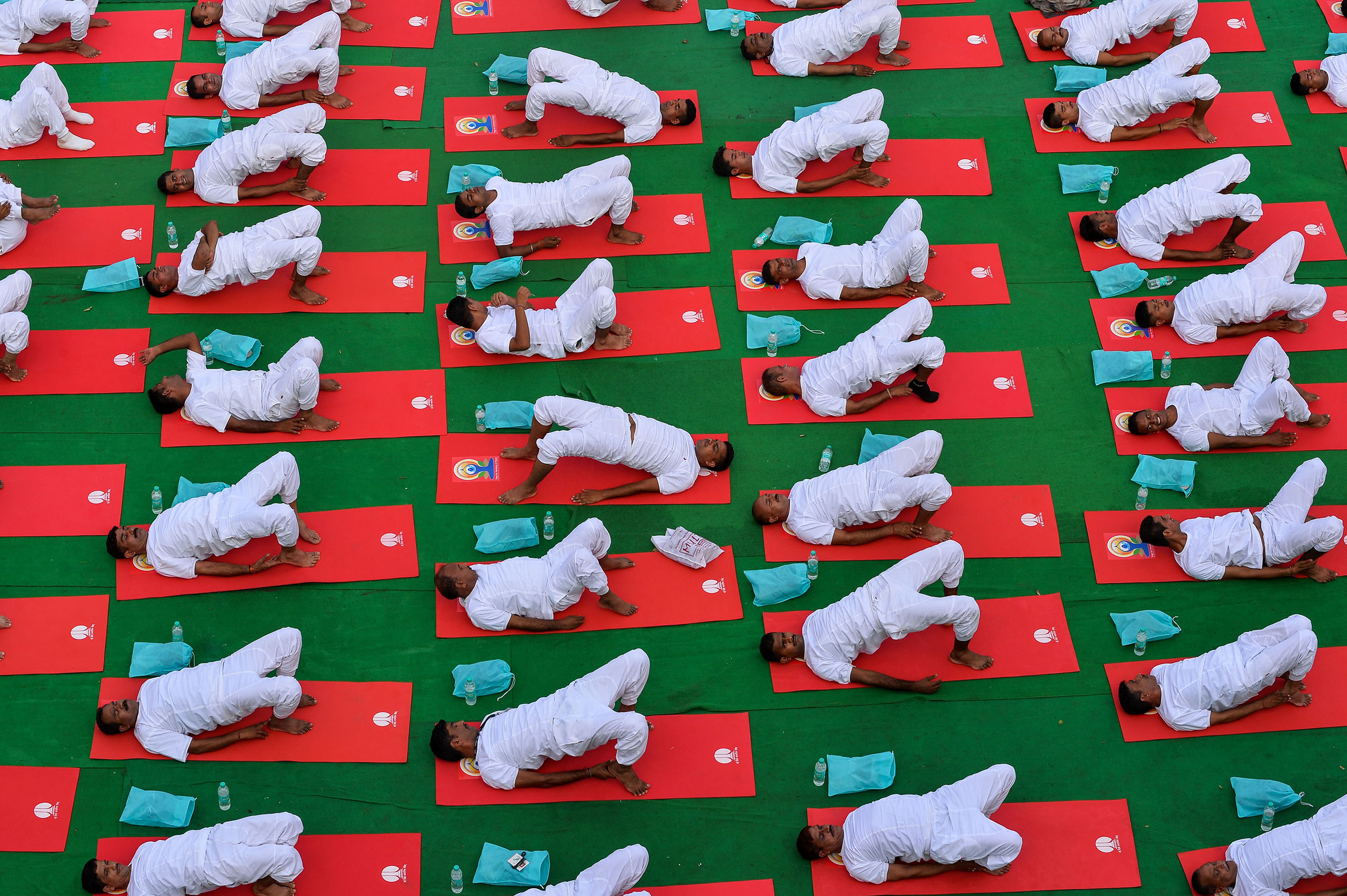 Indian yoga practitioners participate in a mass yoga session on International Yoga Day in New Delhi, India, on June 21, 2016.