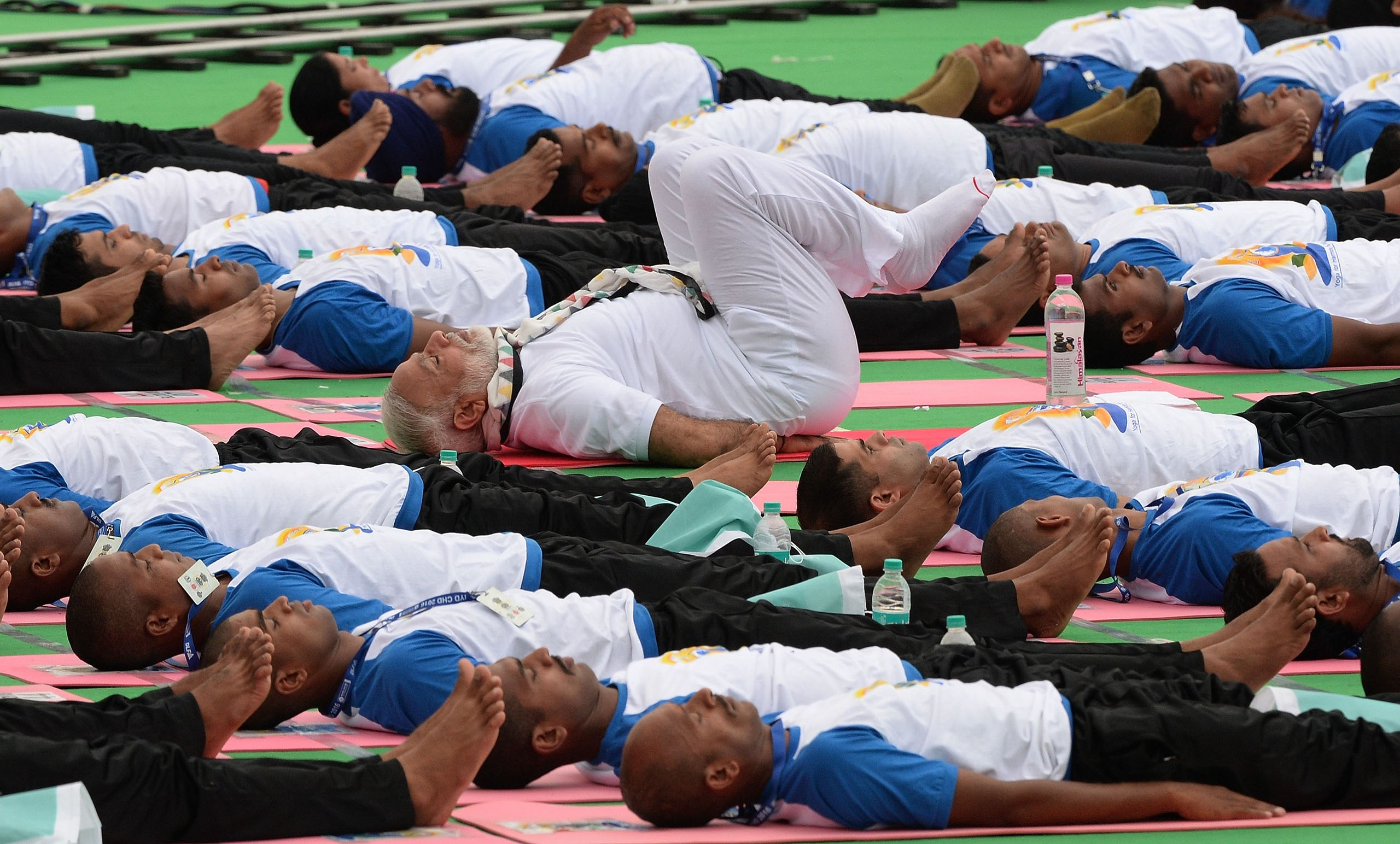 Indian Prime Minister Narendra Modi participates in a mass yoga session along with other Indian yoga practitioners to mark the 2nd International Yoga Day at Captol complex in Chandigarh, India, on June 21, 2016.
