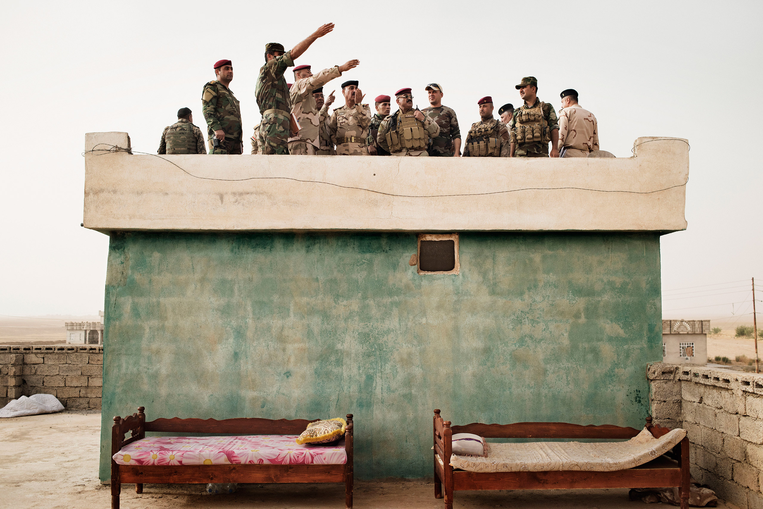 Iraqi Army commanders survey the front line in the villageof Kharbardan, south of Mosul, May 18, 2016. The Iraqi military seized the village from ISIS in March, as a part of a grinding march toward the city of Mosul, a major city that has been under ISIS control since June 2014.From  Yuri Kozyrev: On the Front Lines of the War Against ISIS