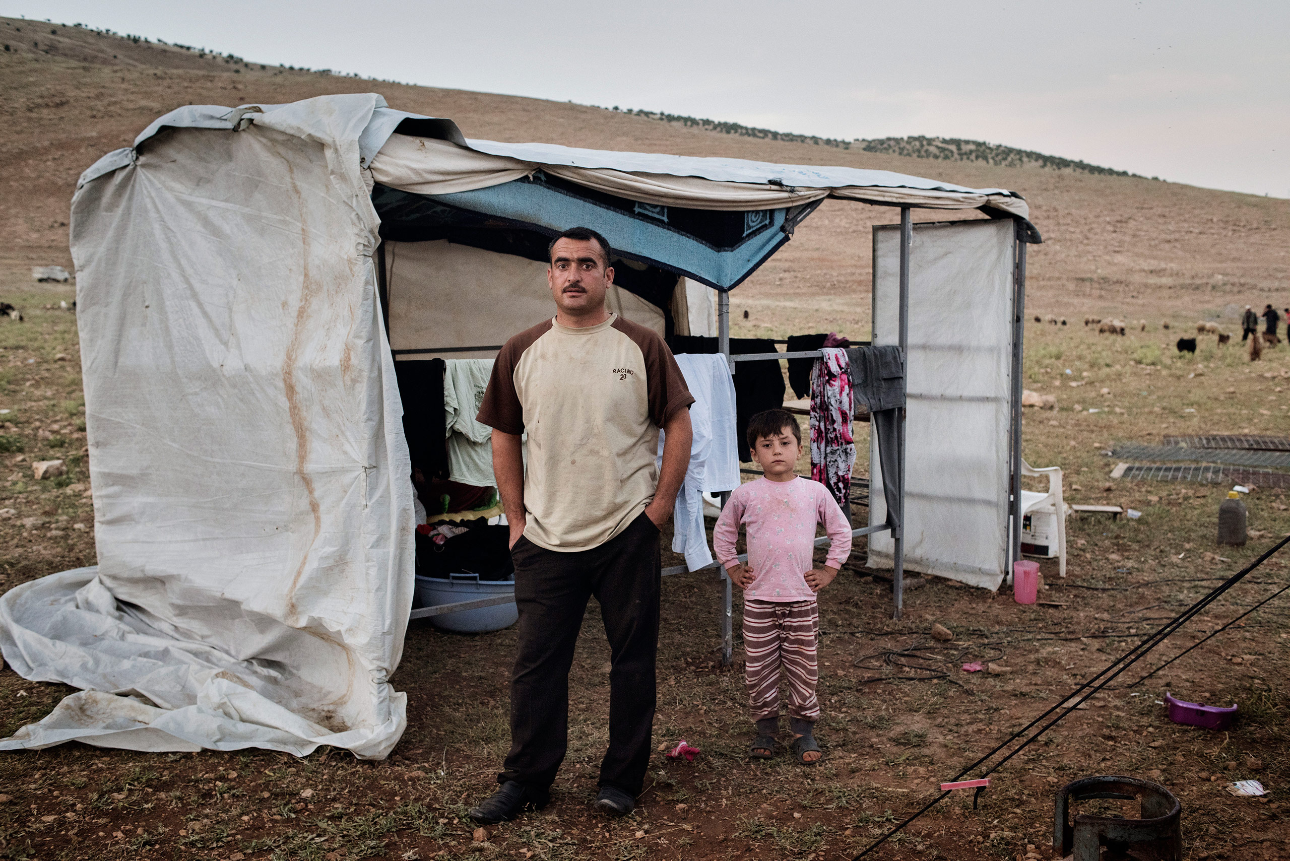 Qubad Miqdad Murad, a police officer in his thirties, stands in a camp for internally displaced people near the Iraqi town of Sinjar, May 13, 2016. Murad returned to Sinjar after Kurdish forces recaptured it from ISIS in Nov. 2015, but he since decided to move to the IDP camp in the mountains above Sinjar, fearing for the safety of his family as ISIS continues to shell the area.From  Yuri Kozyrev: On the Front Lines of the War Against ISIS