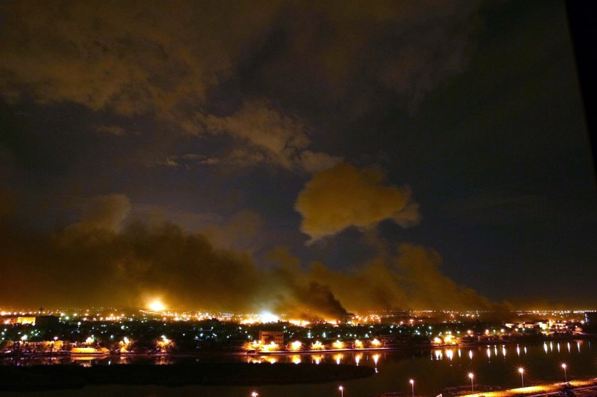 """In a U.S. bombing campaign known as """"Shock and Awe,"""" a barrage of bombs rained on the government district of Baghdad in a war waged against the regime of Saddam Hussein, March 21, 2003."""